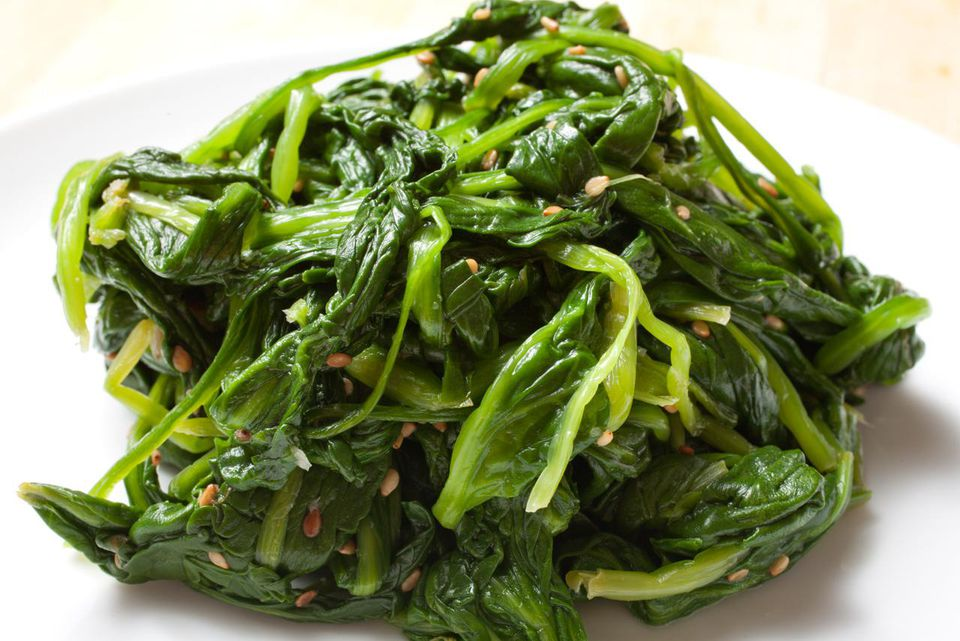 Sigumchi Namul (Korean spiced spinach) on a white plate