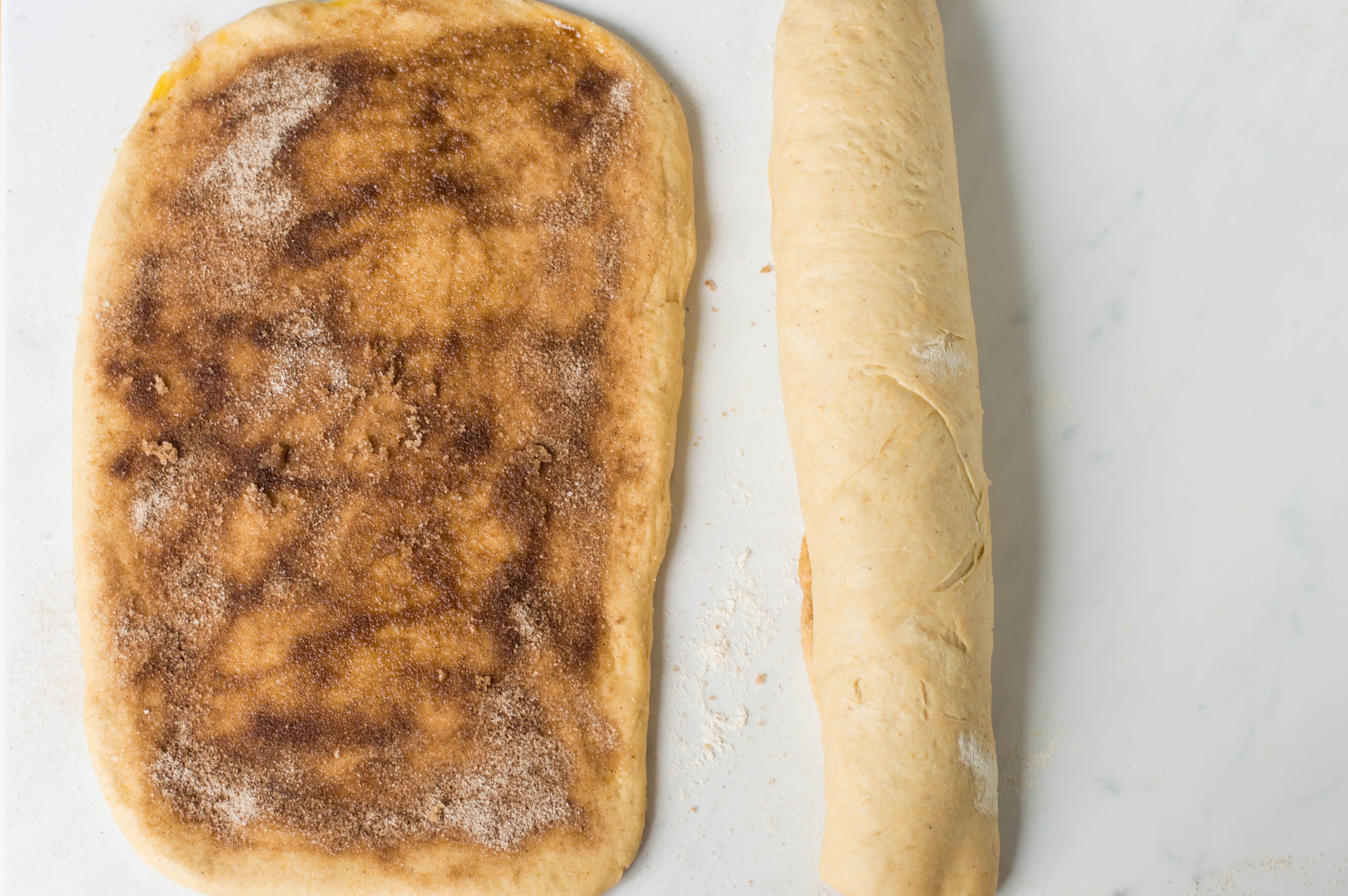 Cinnamon sugar mixture sprinkled onto dough