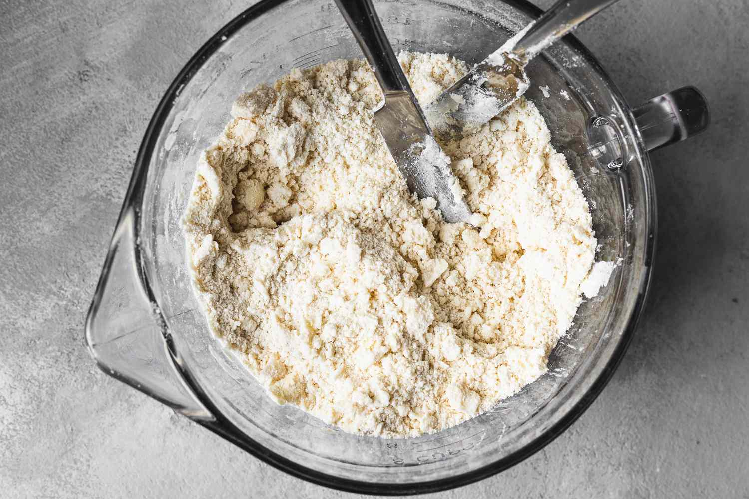 Lard and butter cut into the flour mixture with knives