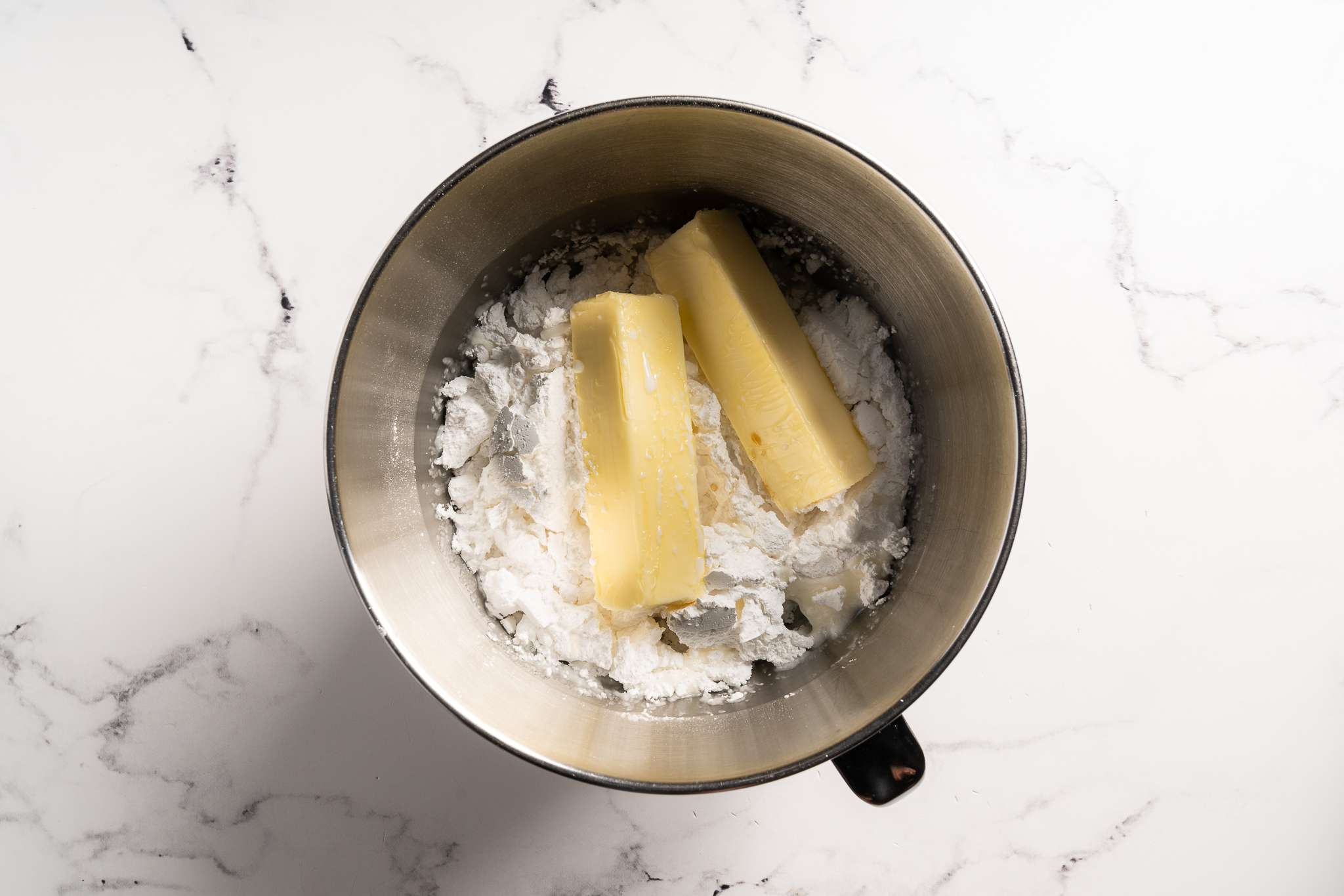 Frosting ingredients in a mixing bowl