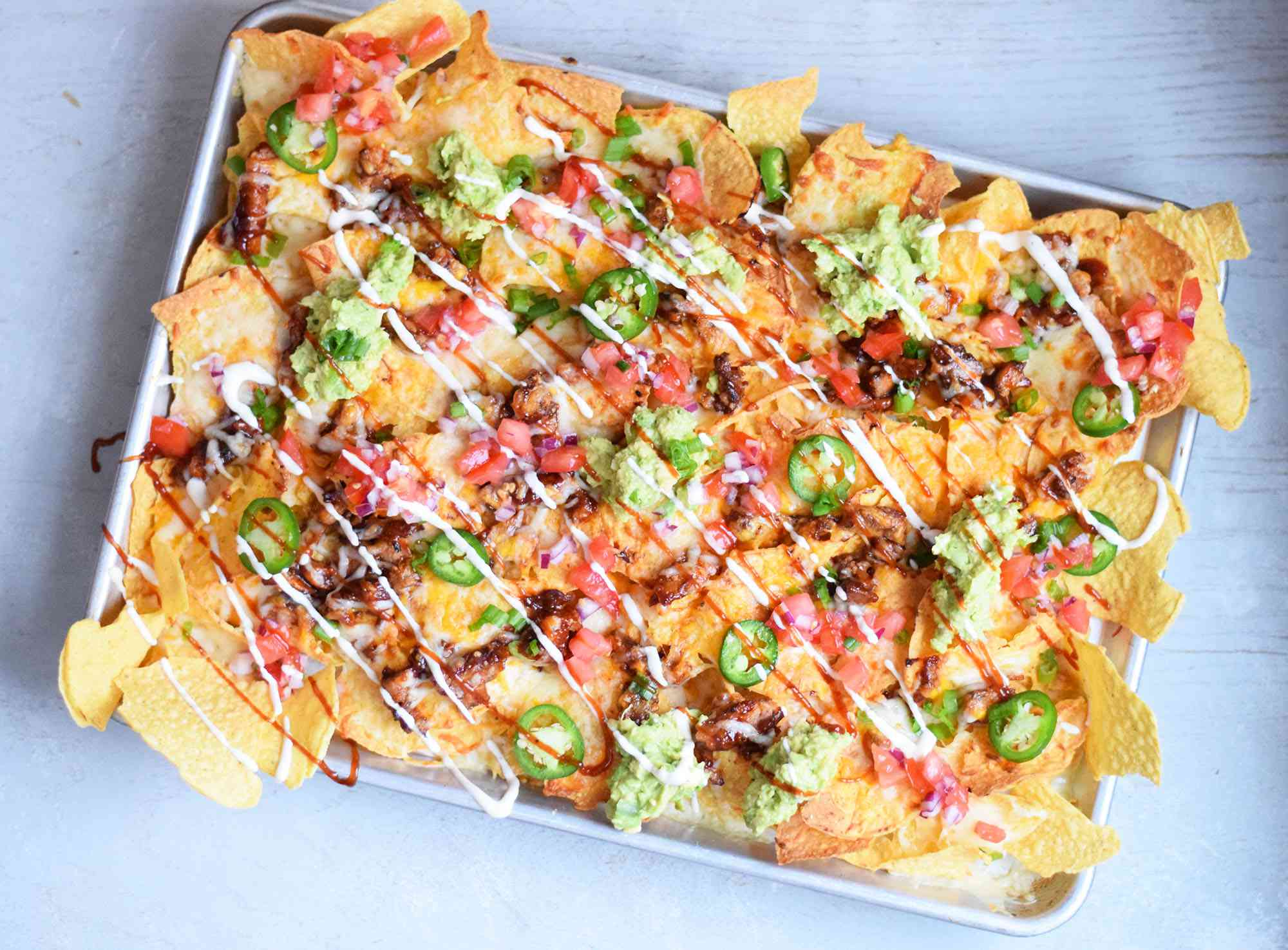 nachos topped with barbecue sauce