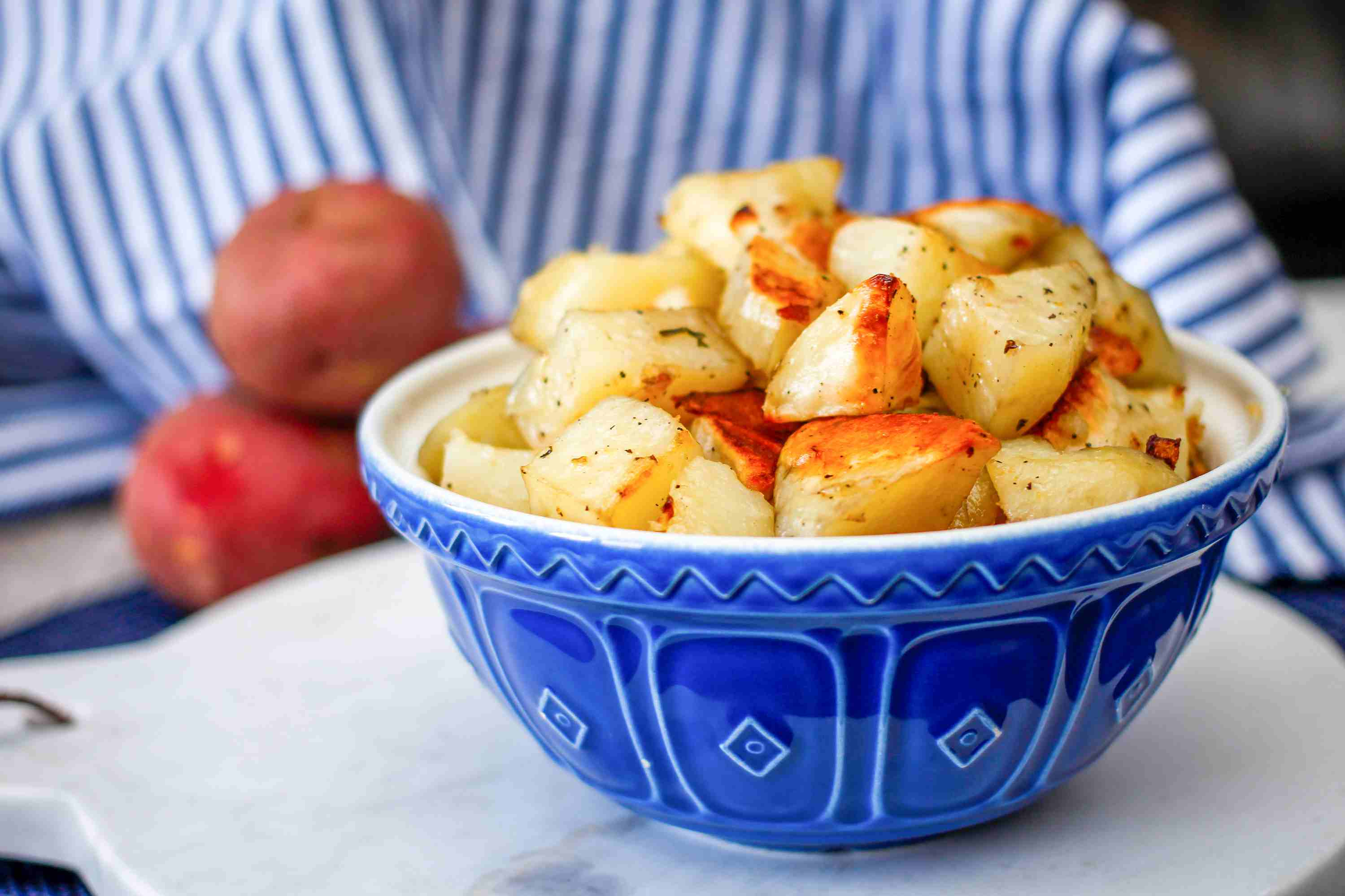 Roasted potatoes with garlic and onions in bowl