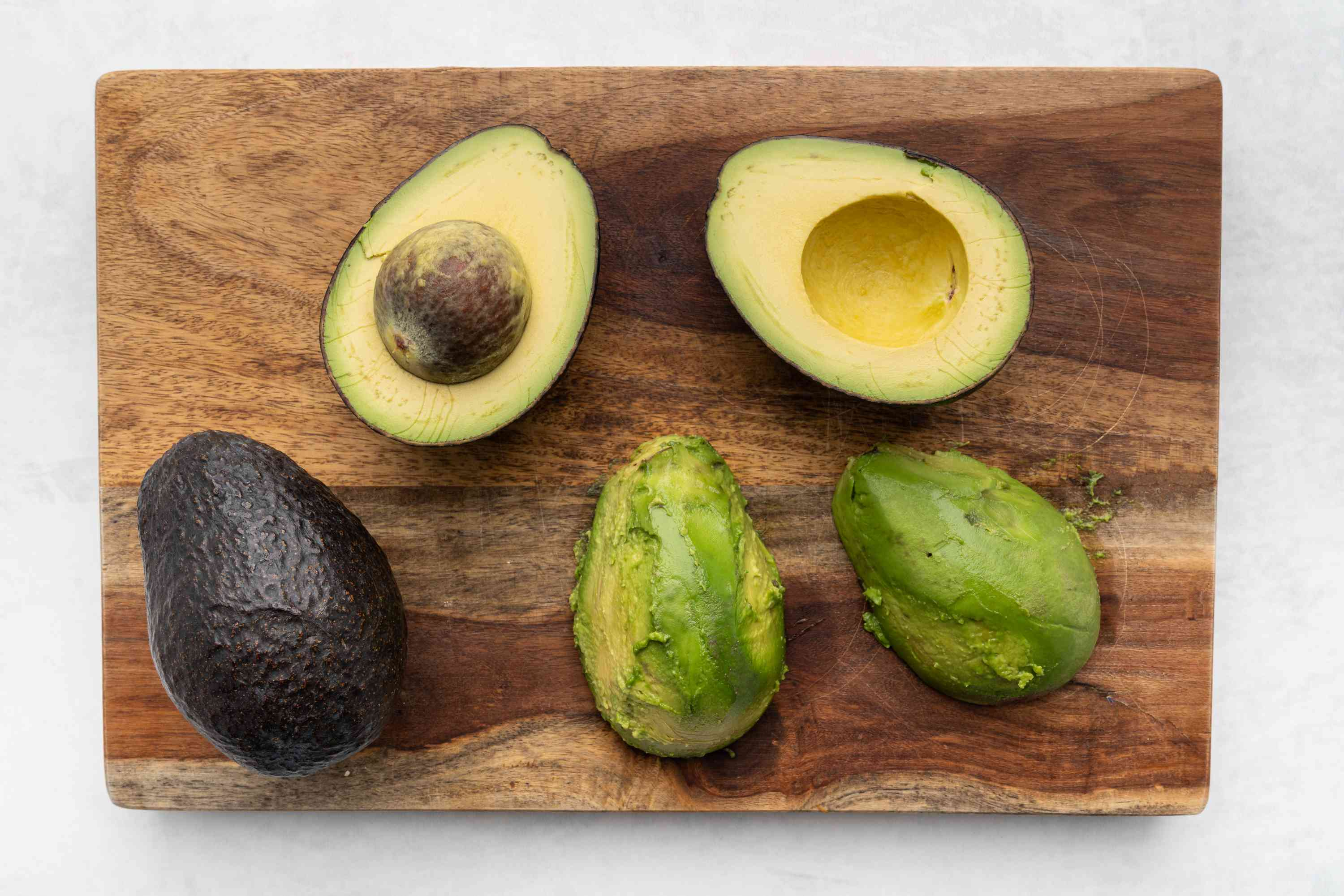 Cut open the avocados and remove the flesh