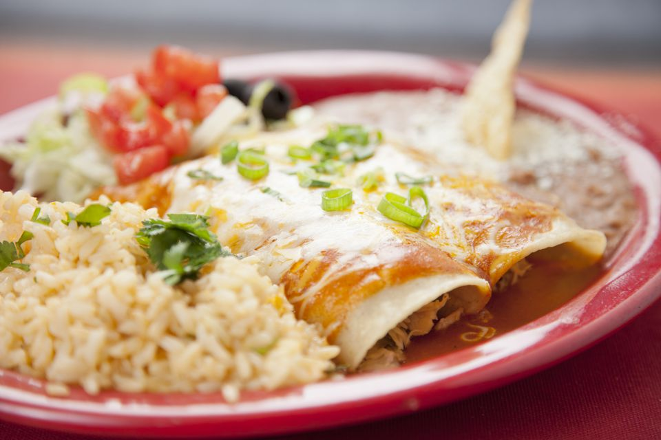 Enchiladas Suizas with red sauce, rice and beans