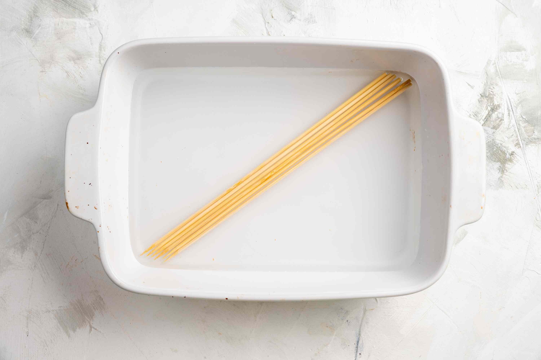 Soak the bamboo skewers in water