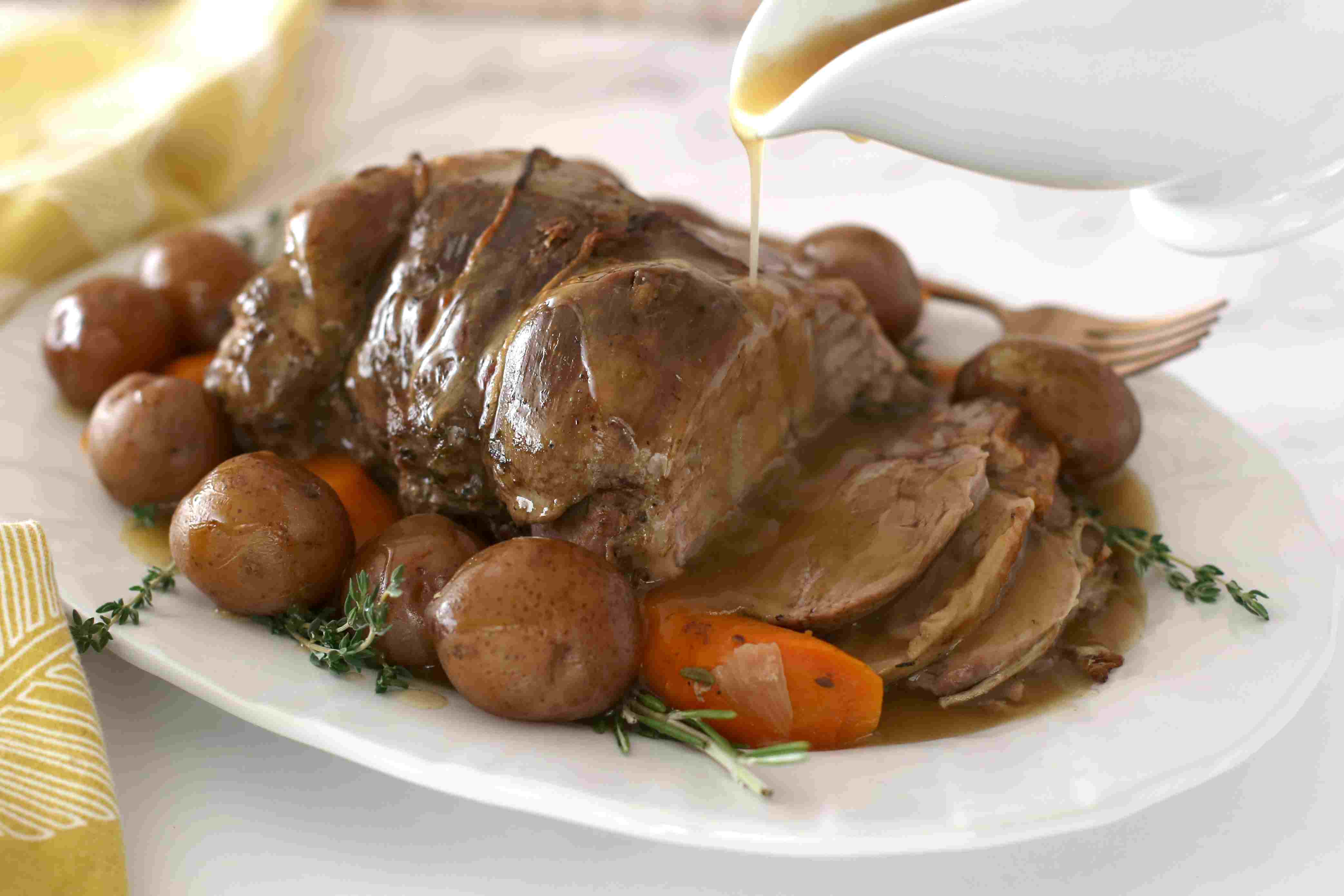 Gravy poured over the Ieg of lamb