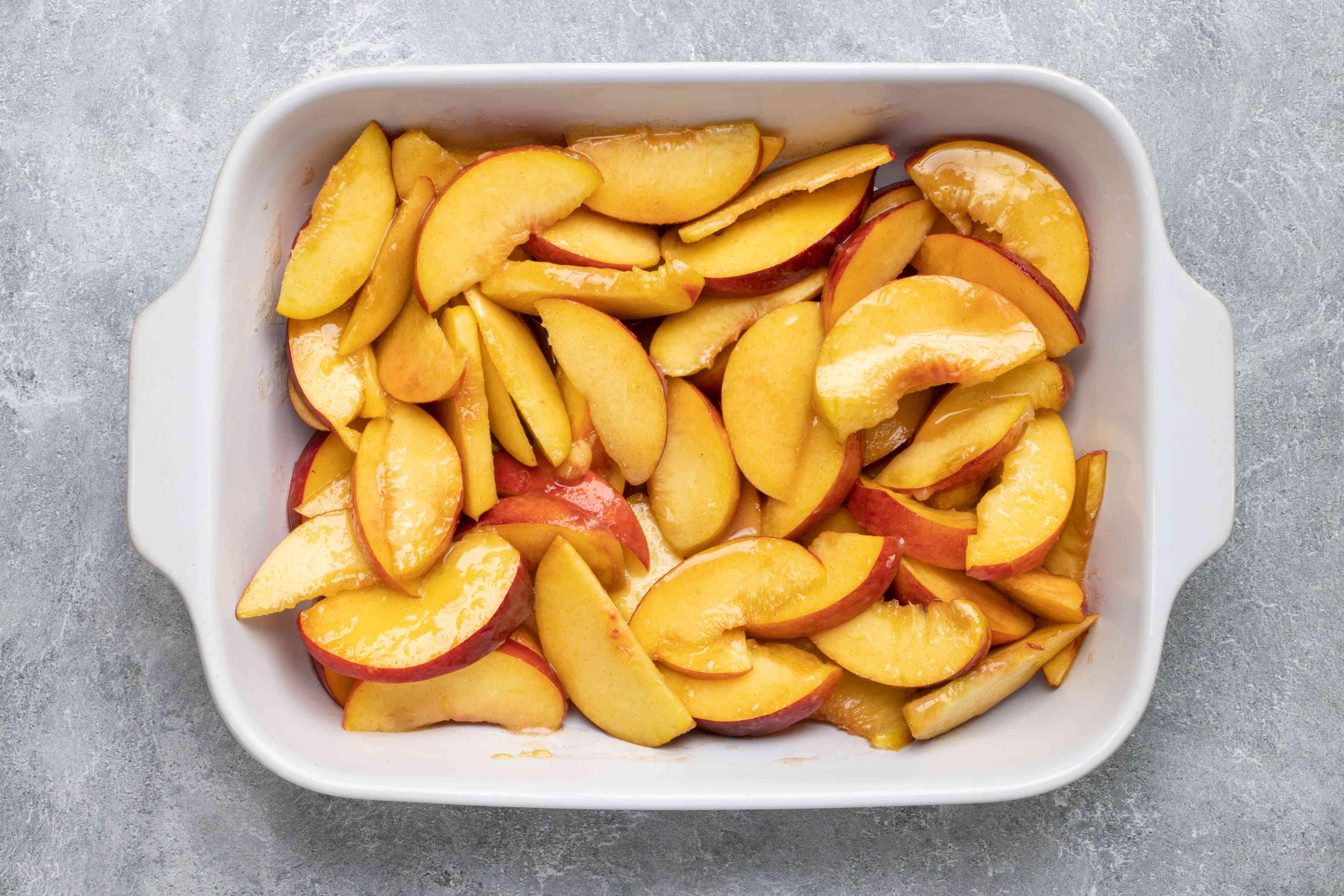 peaches in a baking dish for peach cobbler.