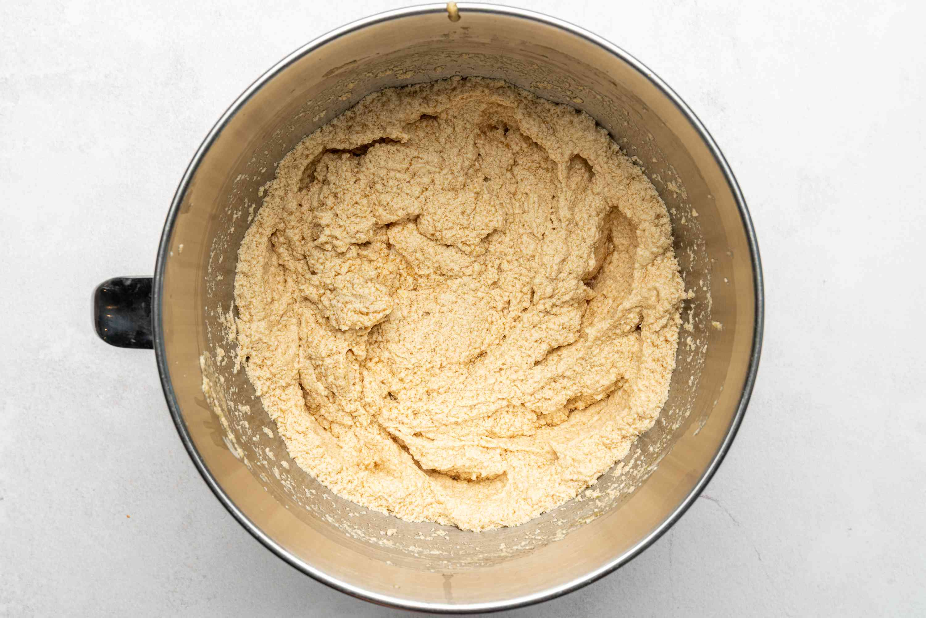 cream the butter, brown sugar, eggs, and flavor extracts in a bowl