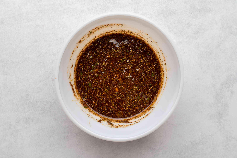 Combine vinegar, oil, cilantro, water, garlic, lime, salt, pepper, and spices