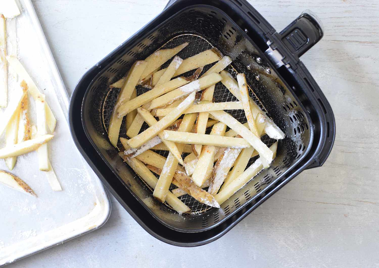 Add fries to air fryer