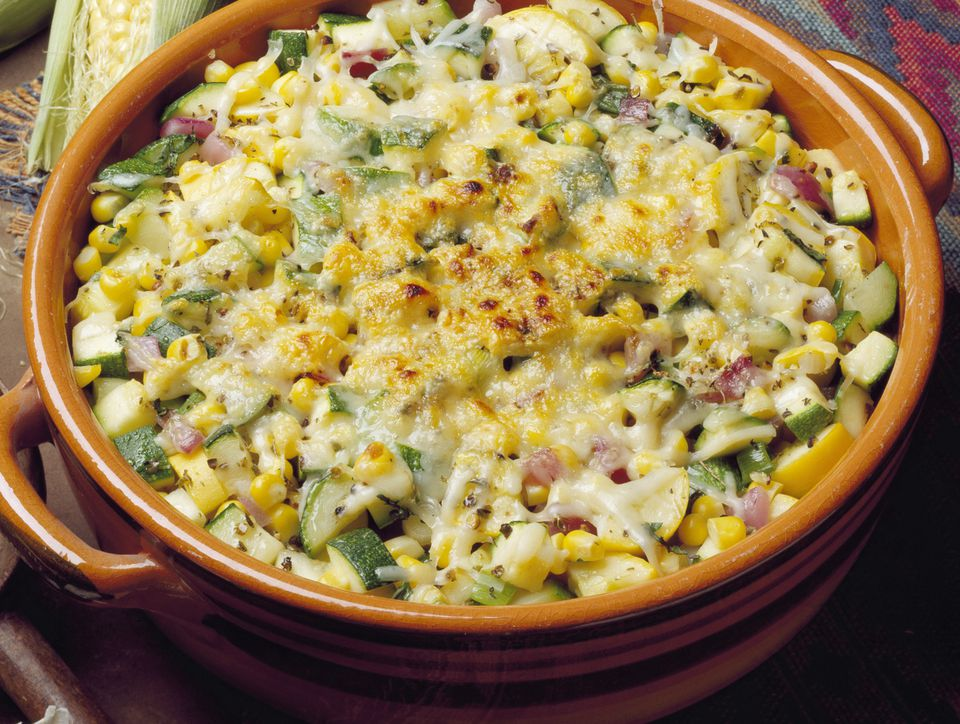 Hominy casserole topped with cheese