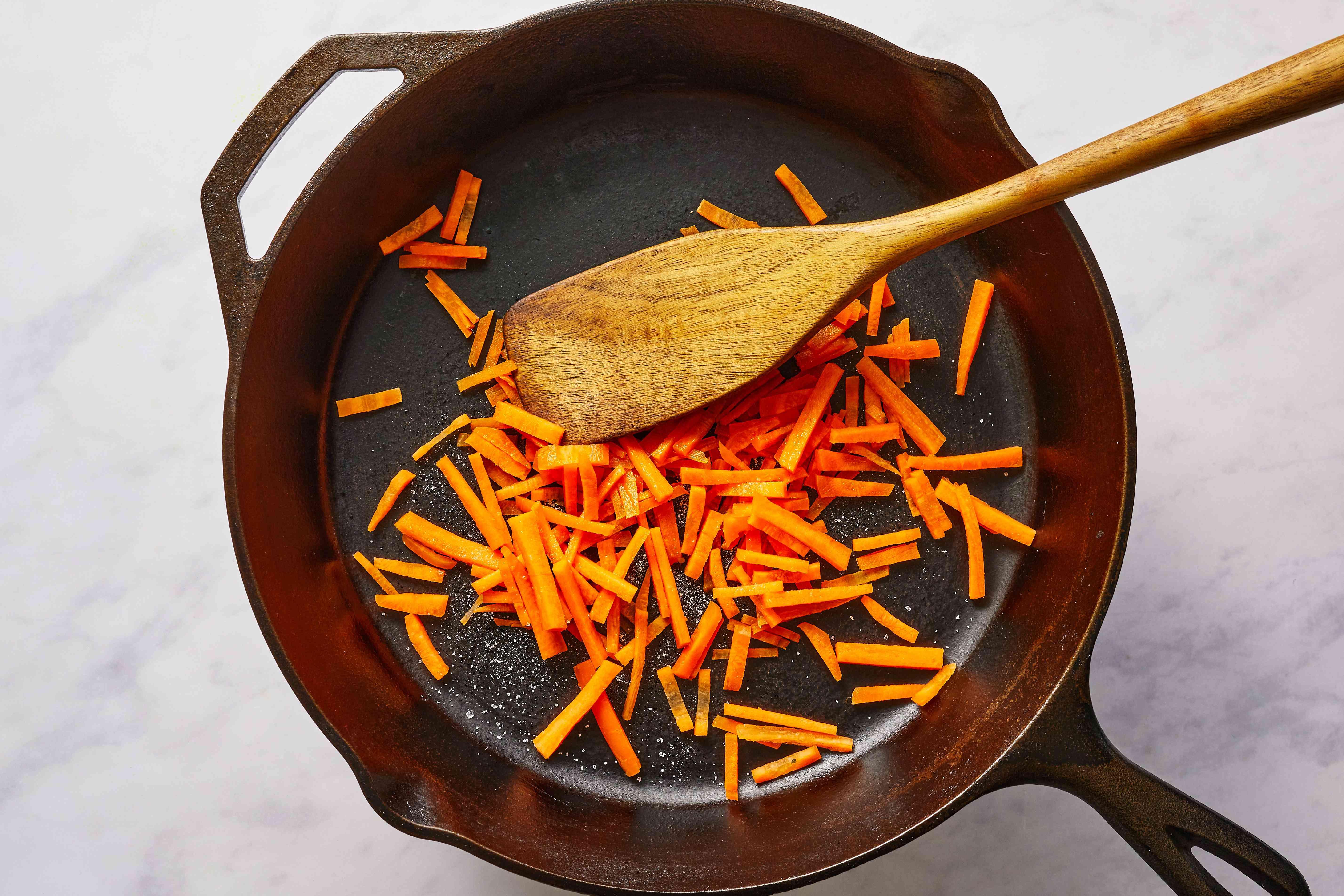 Saute carrots with salt