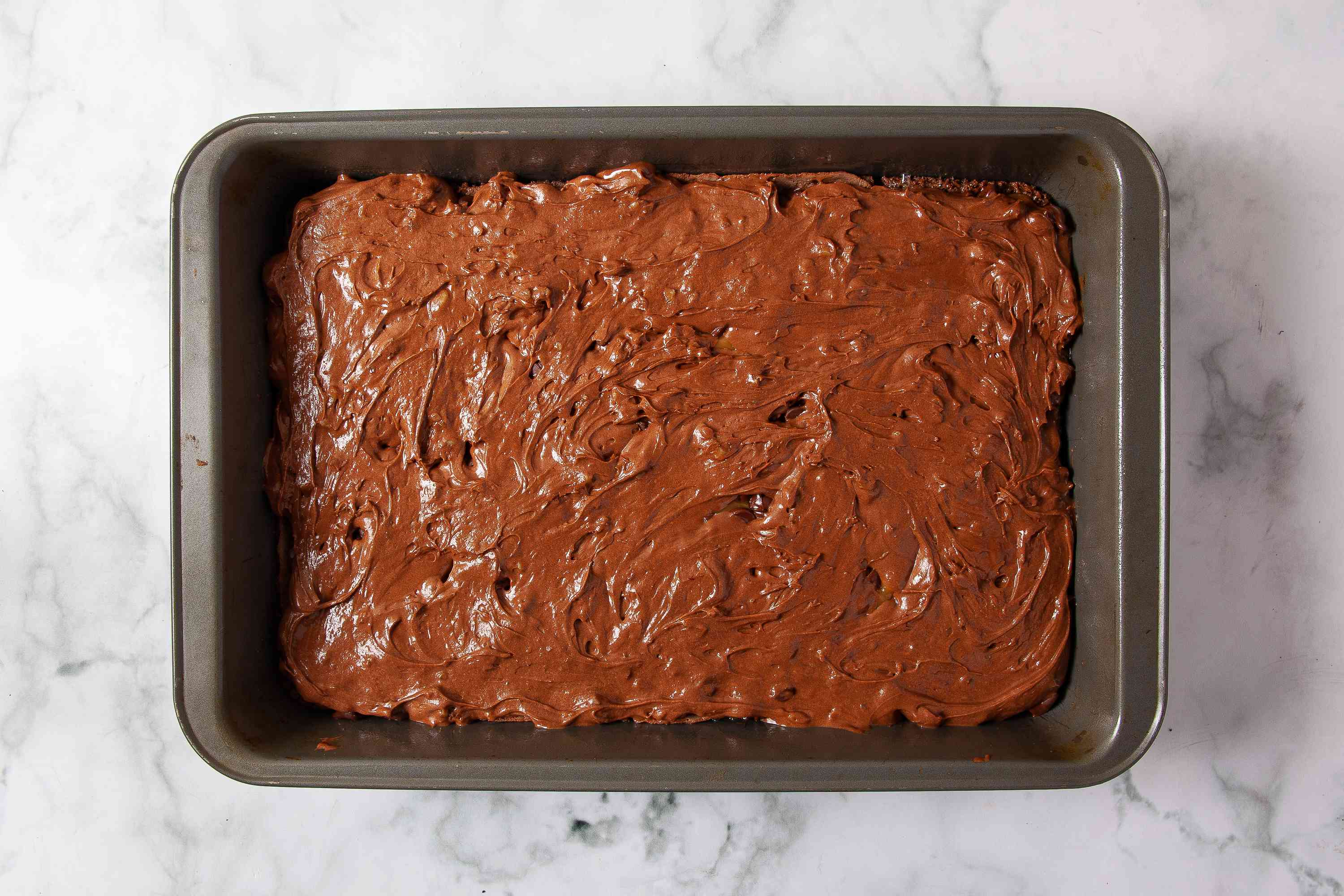 Remaining brownie batter spread on top