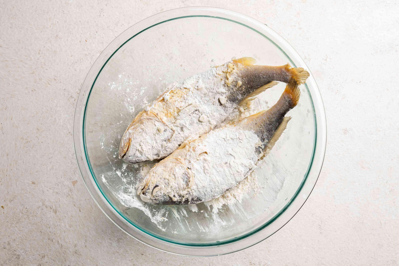 Dip fish into the flour mixture