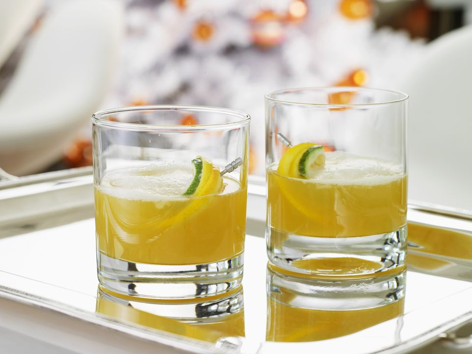 Citrus sour cocktails on silver tray, close up