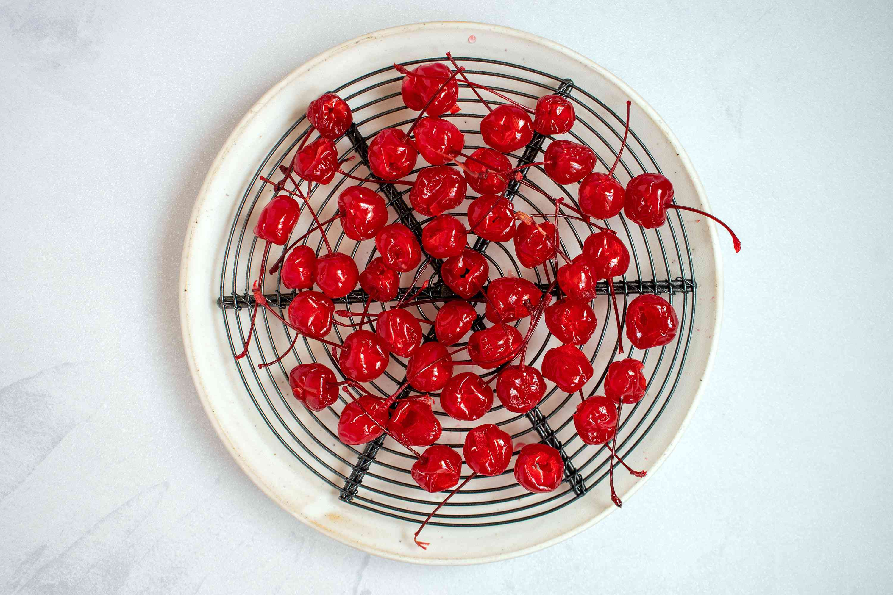 Cherries drying on a wire rack