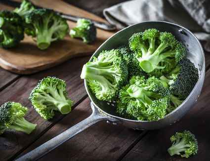 Broccoli in an old metal colander