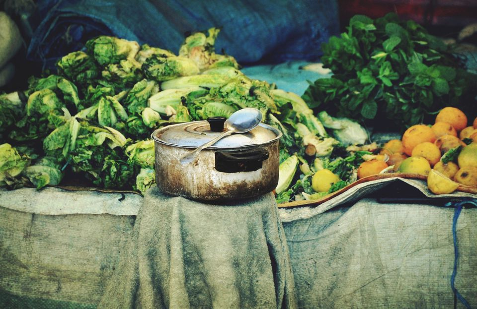 Cooking utensil against Chinese cabbages at a market