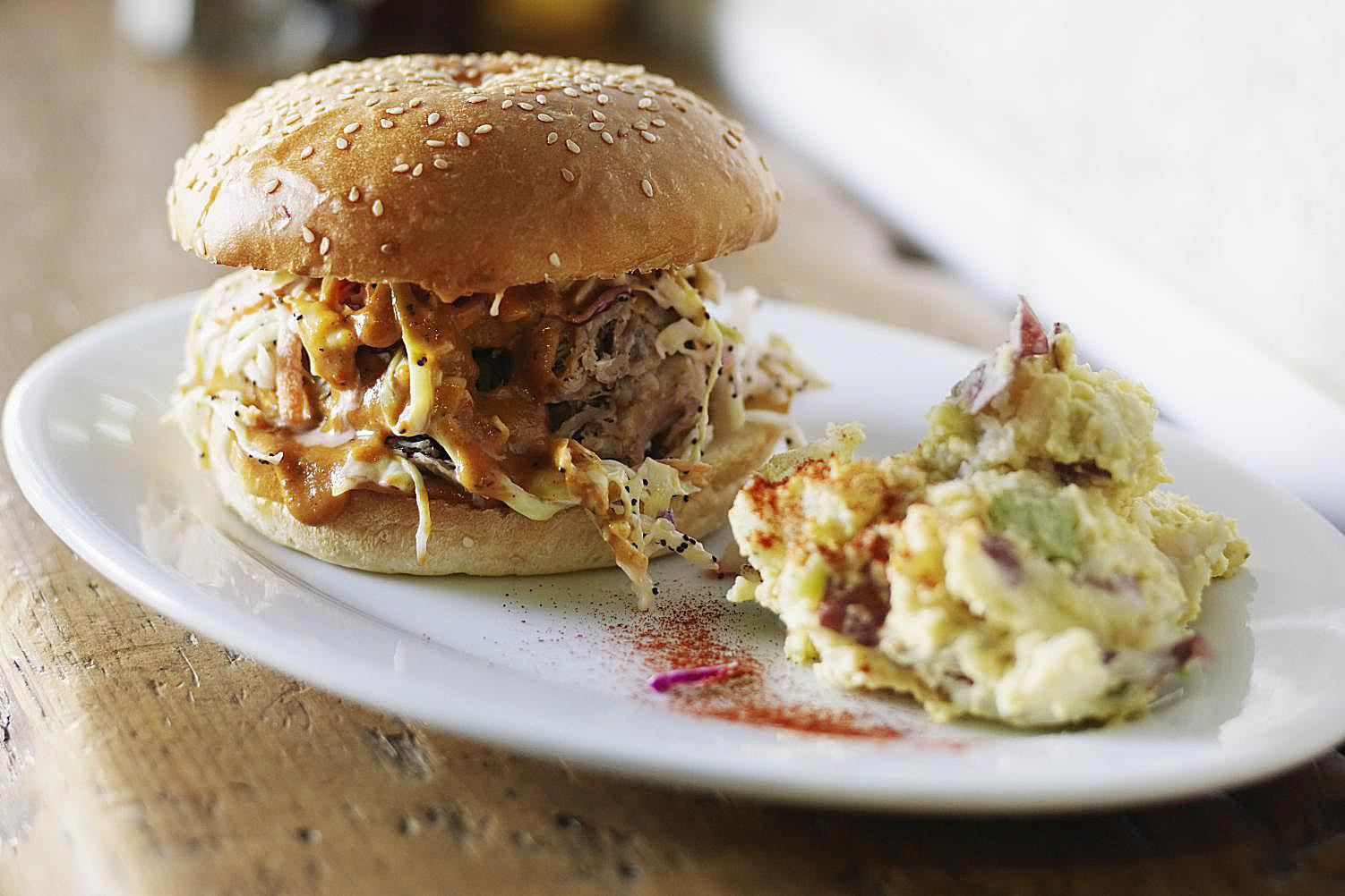 Pulled pork sandwich served with coleslaw