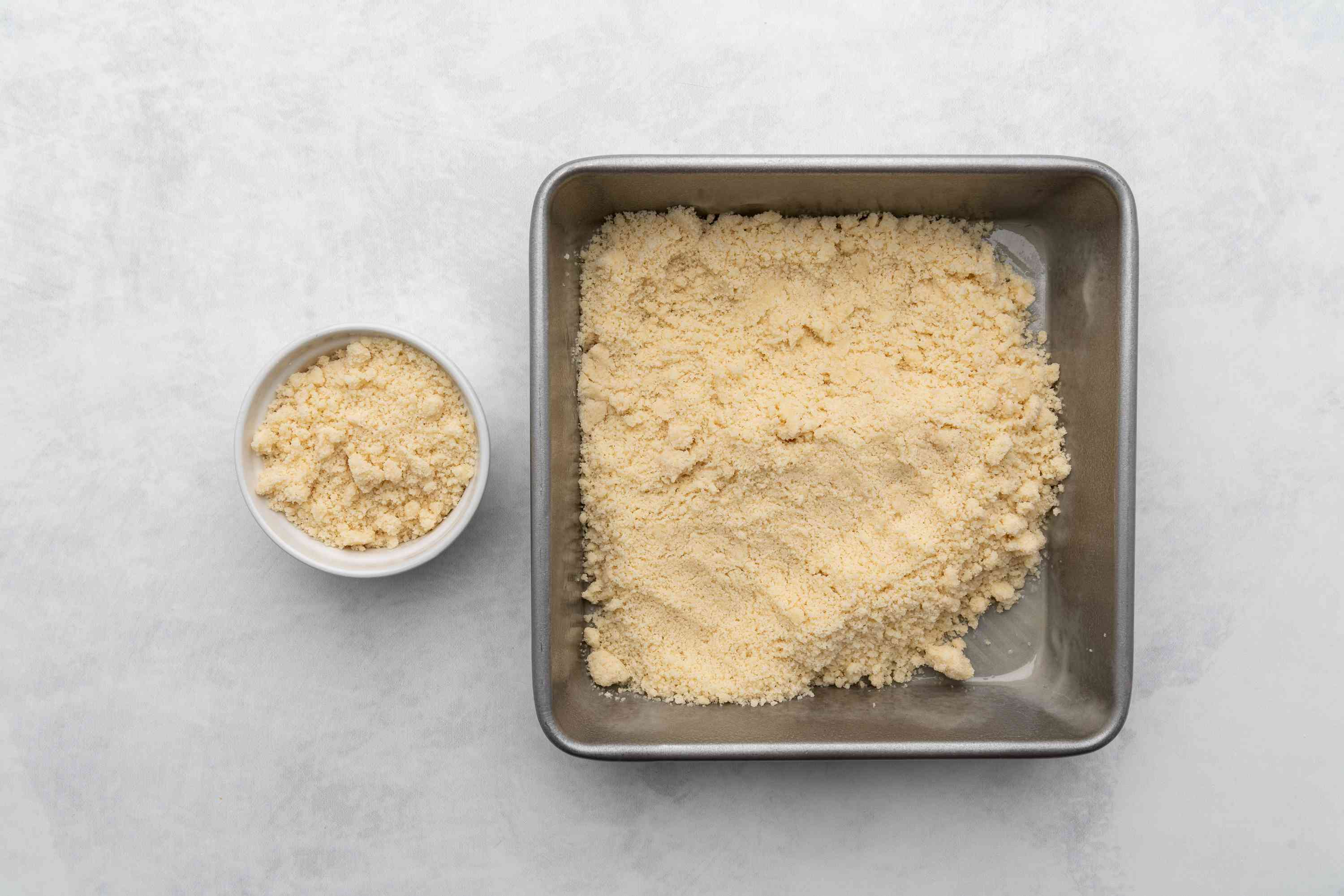 reserved flour mixture in small bowl, remaining flour mixture being pressed into pan