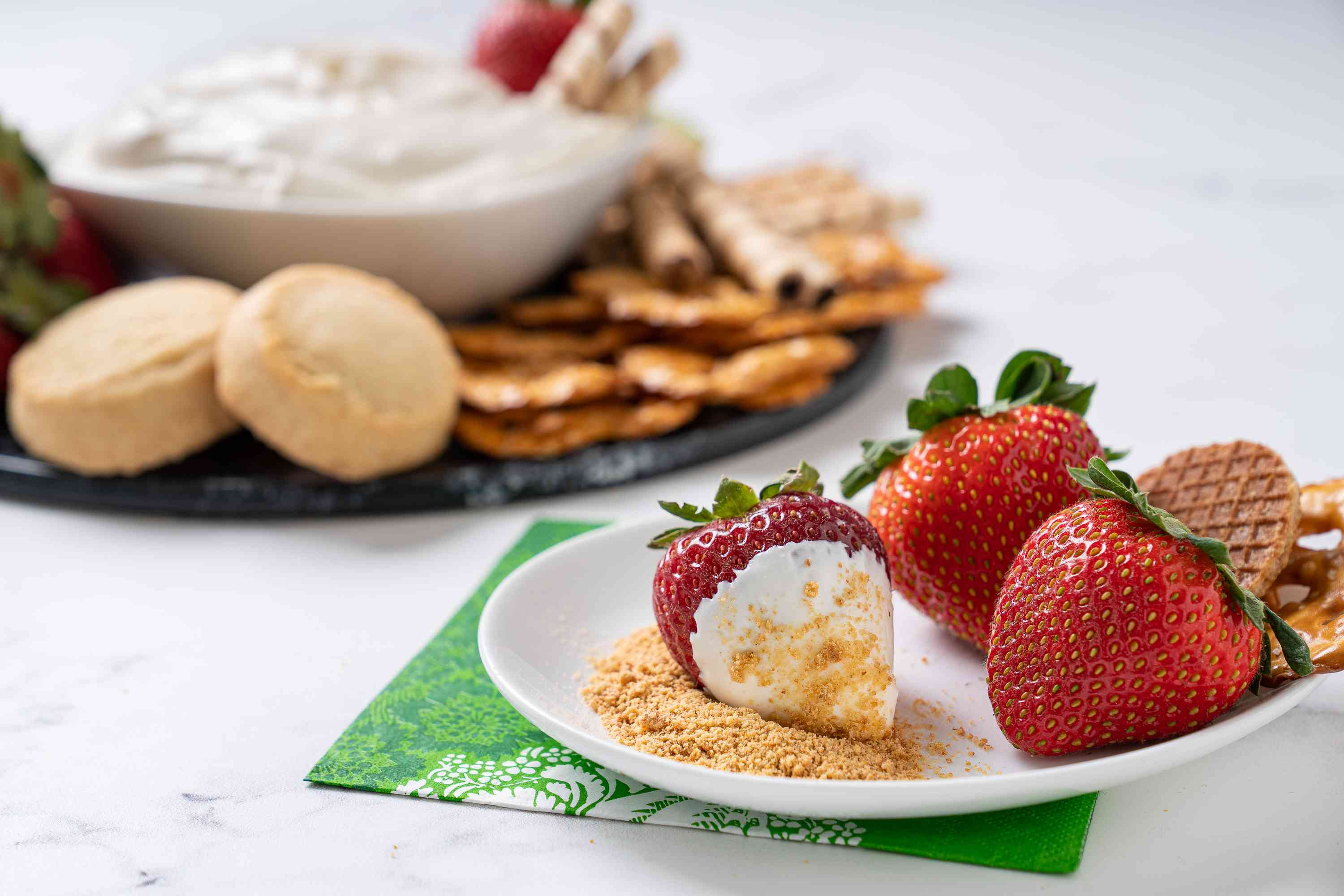 Cheesecake Dip served with strawberries and graham crackers
