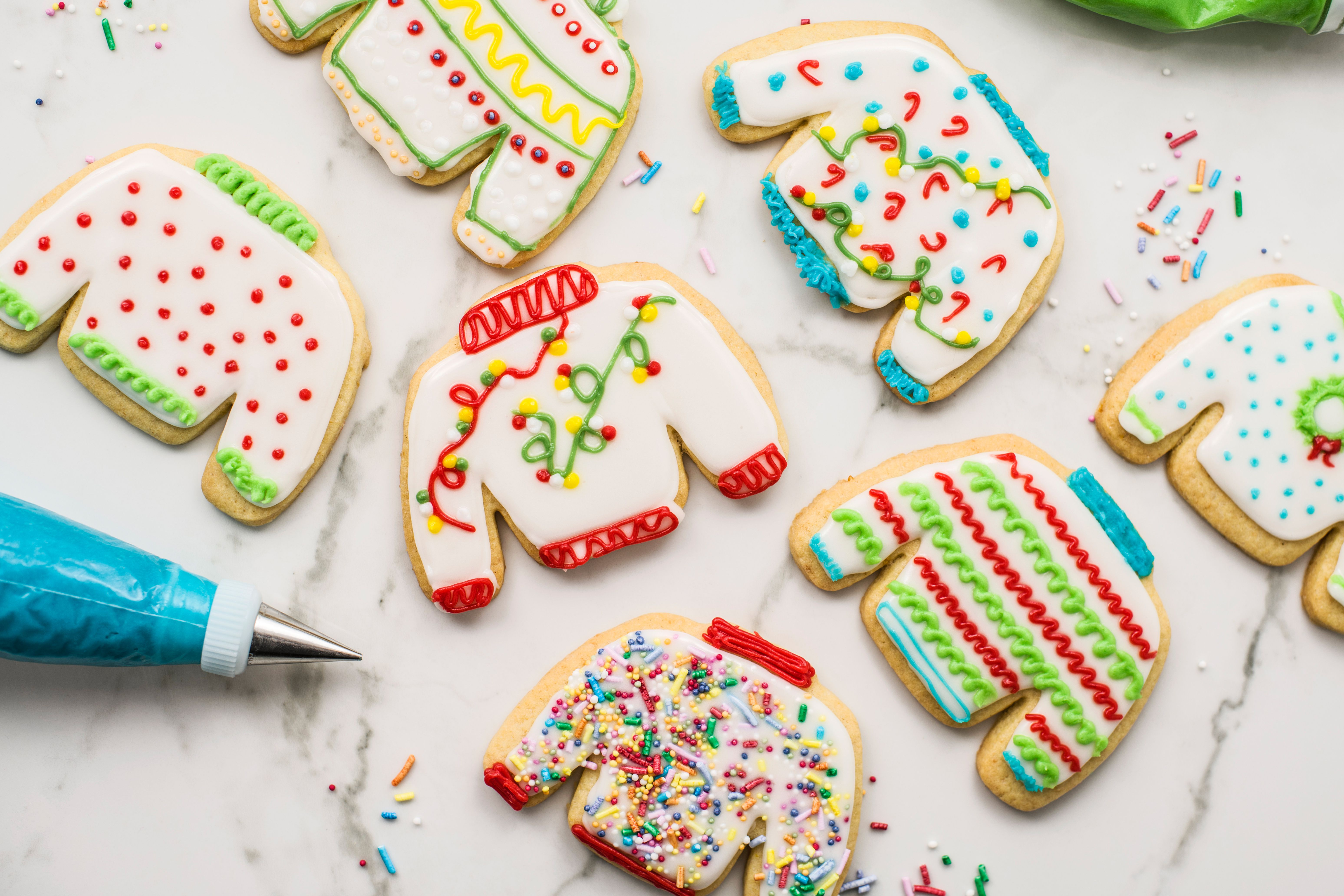 Decorating ugly sweater cookies with frosting