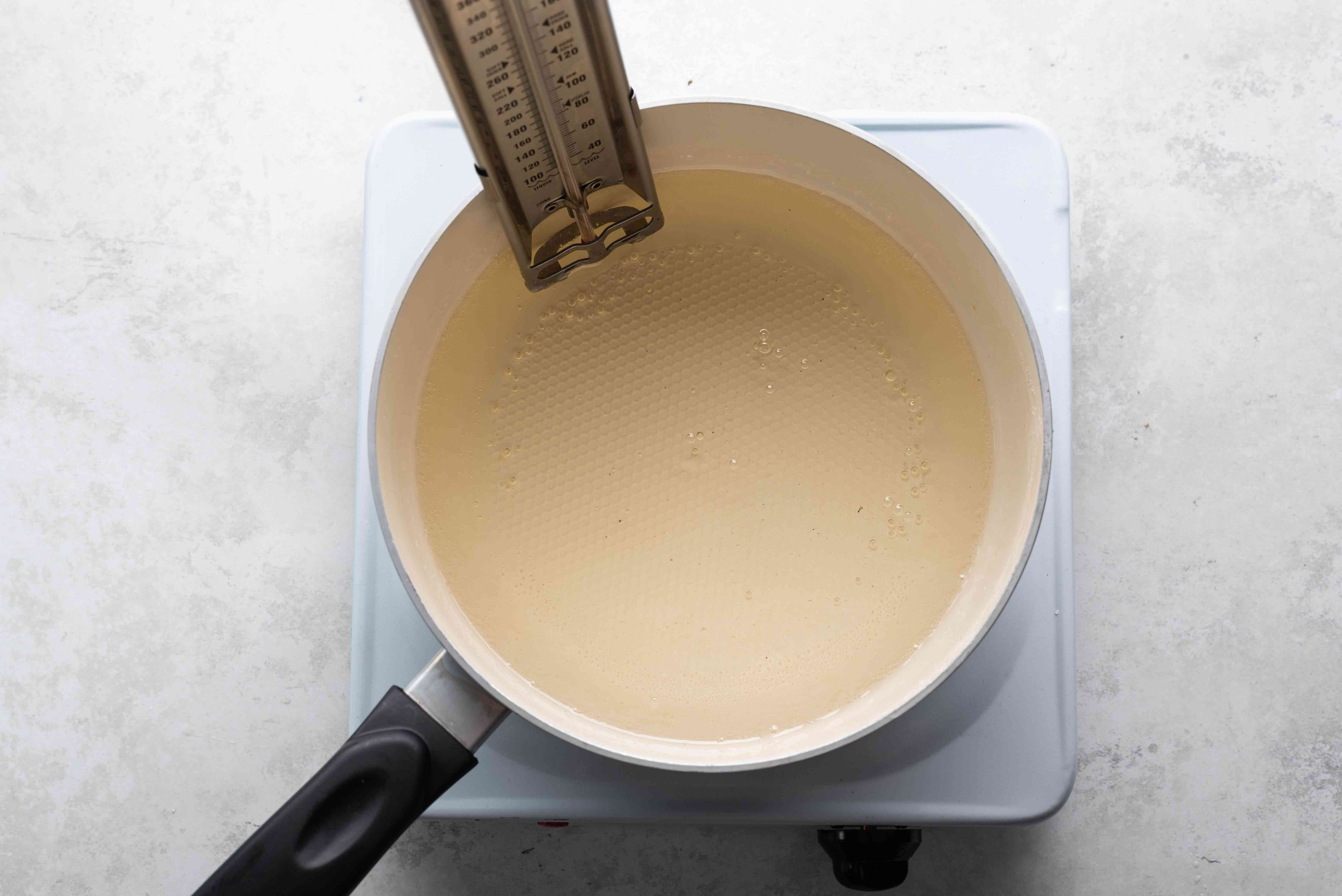 syrup in a saucepan, sugar thermometer