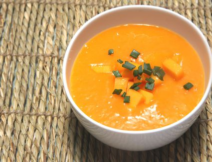 Raw vegan mango soup in white bowl