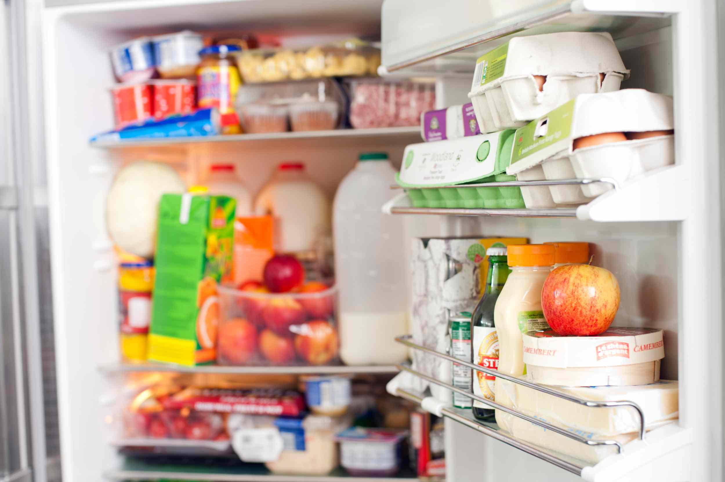 messy unorganized refrigerator