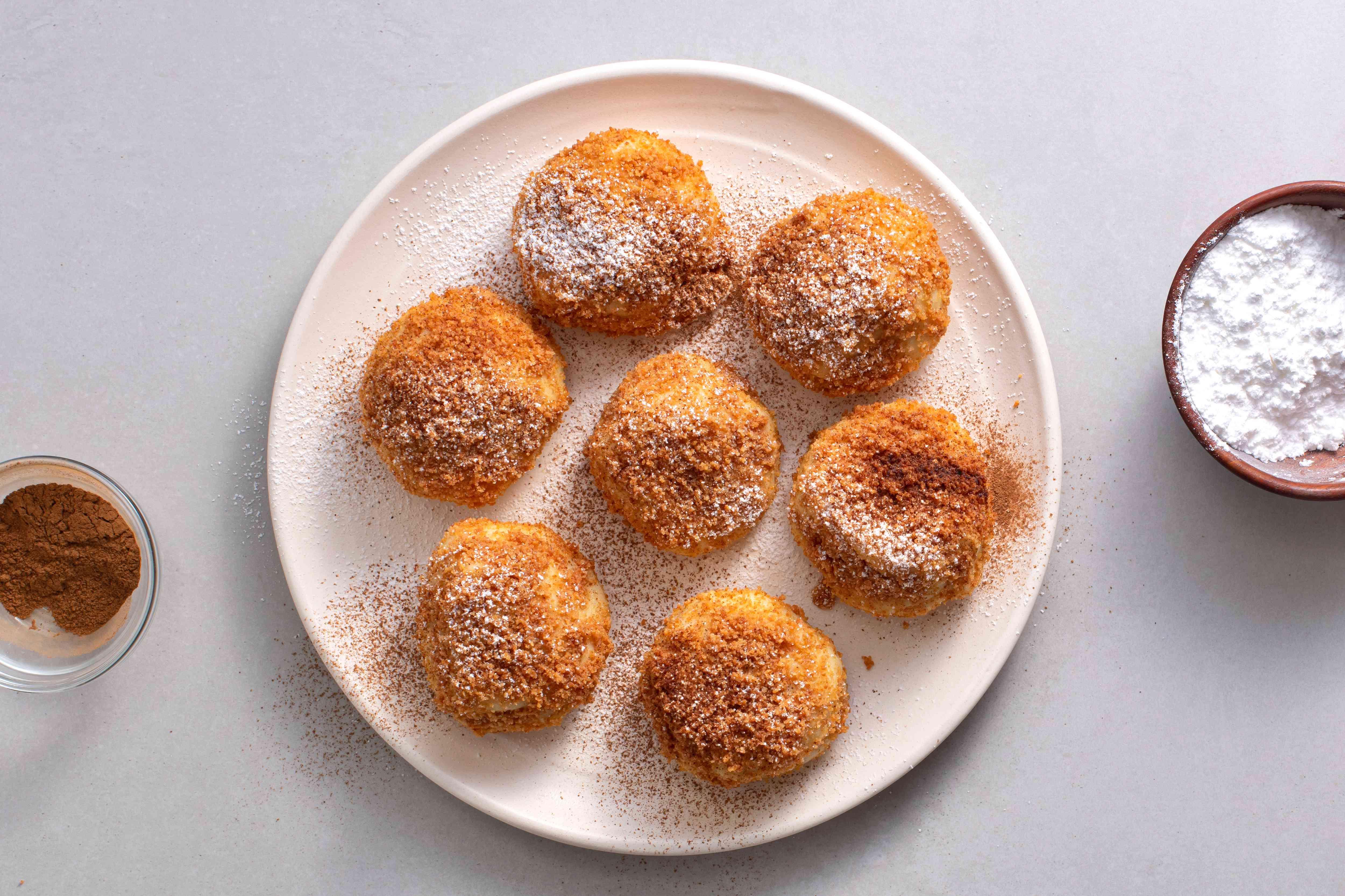 Croatian Plum Dumplings Recipe - Knedle s Sljivama on a platter