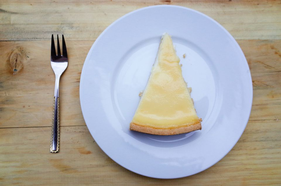 High Angle View of Cheesecake and Fork On Table
