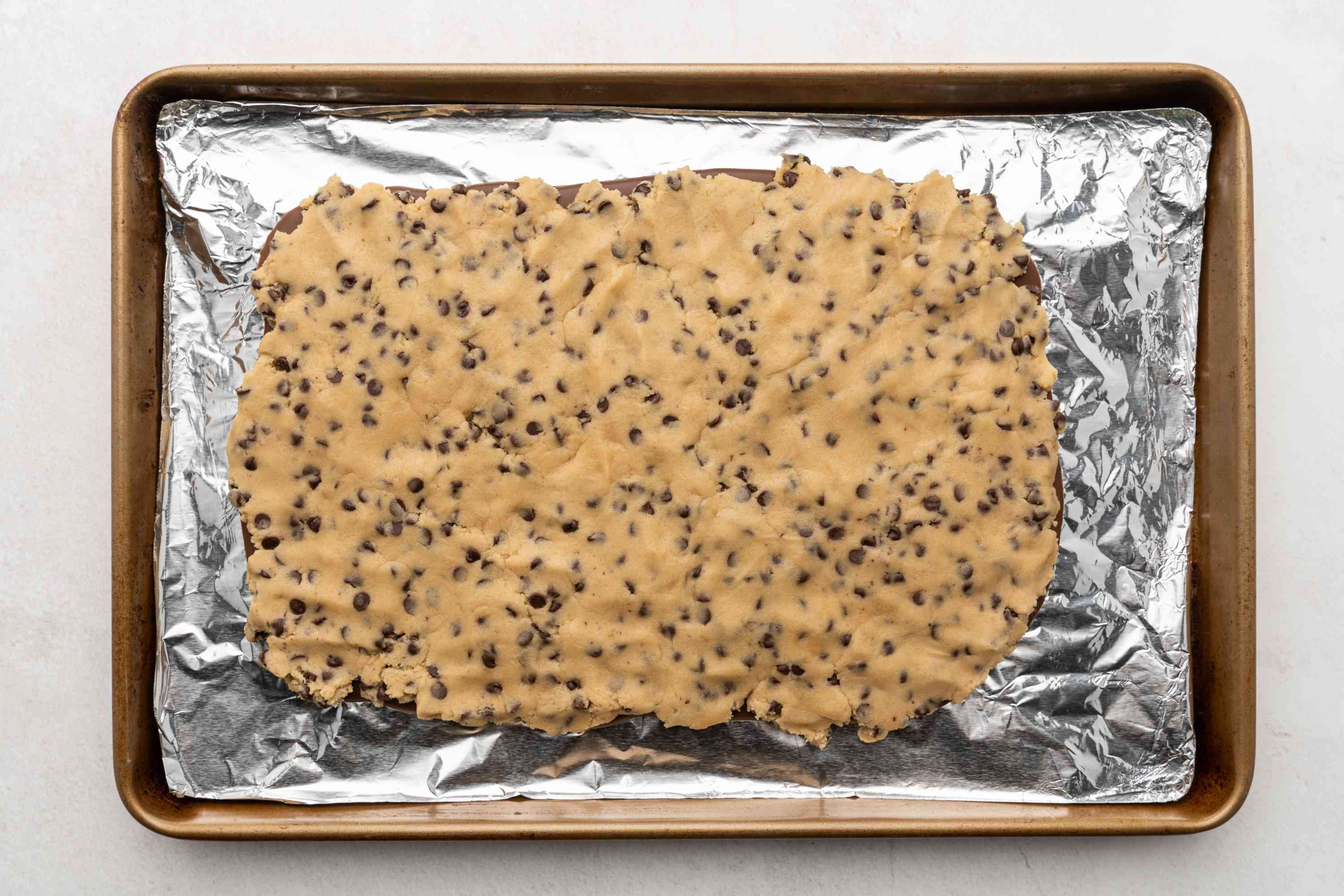 dough on top of the chocolate on a baking sheet