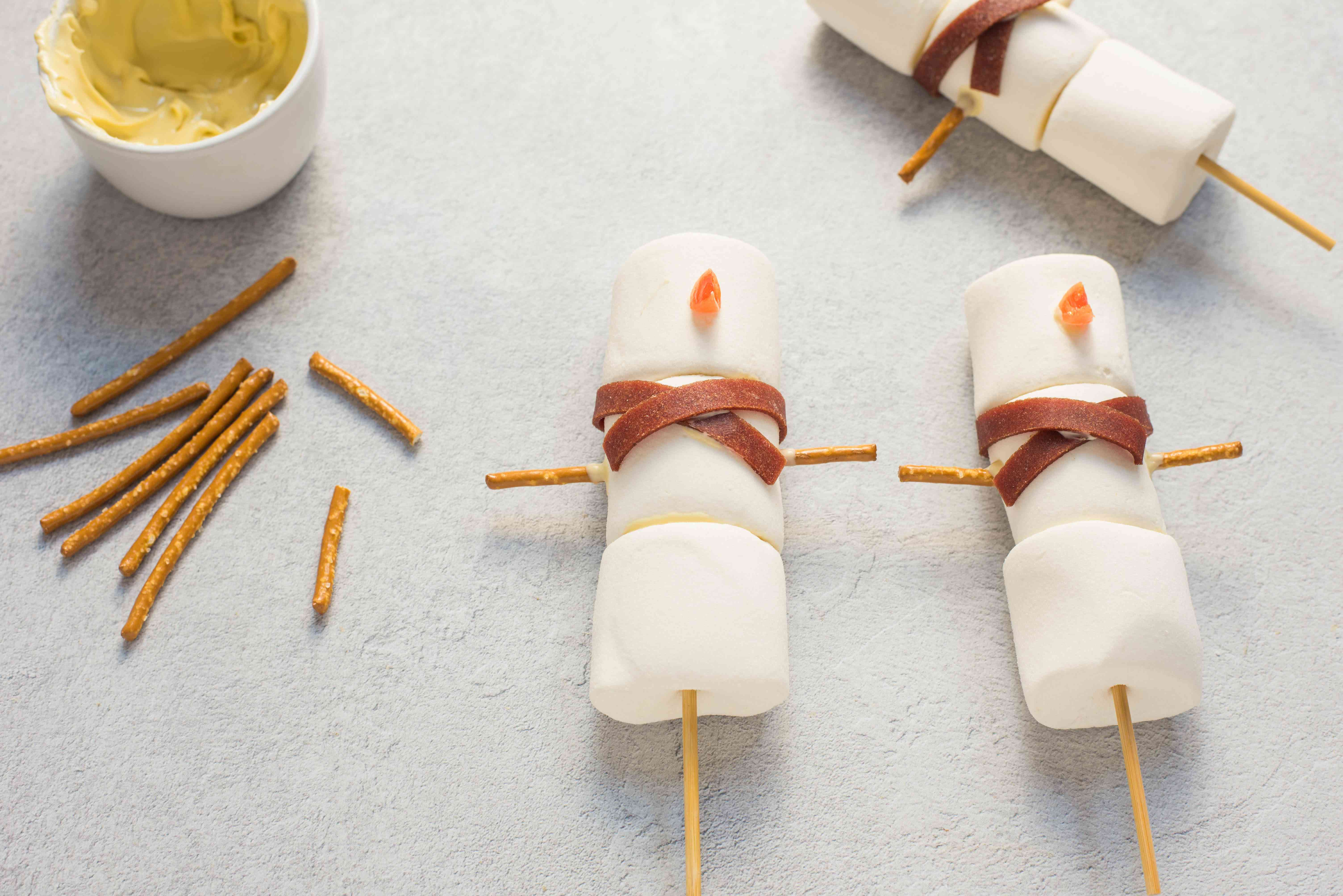 Cut pretzel sticks in half