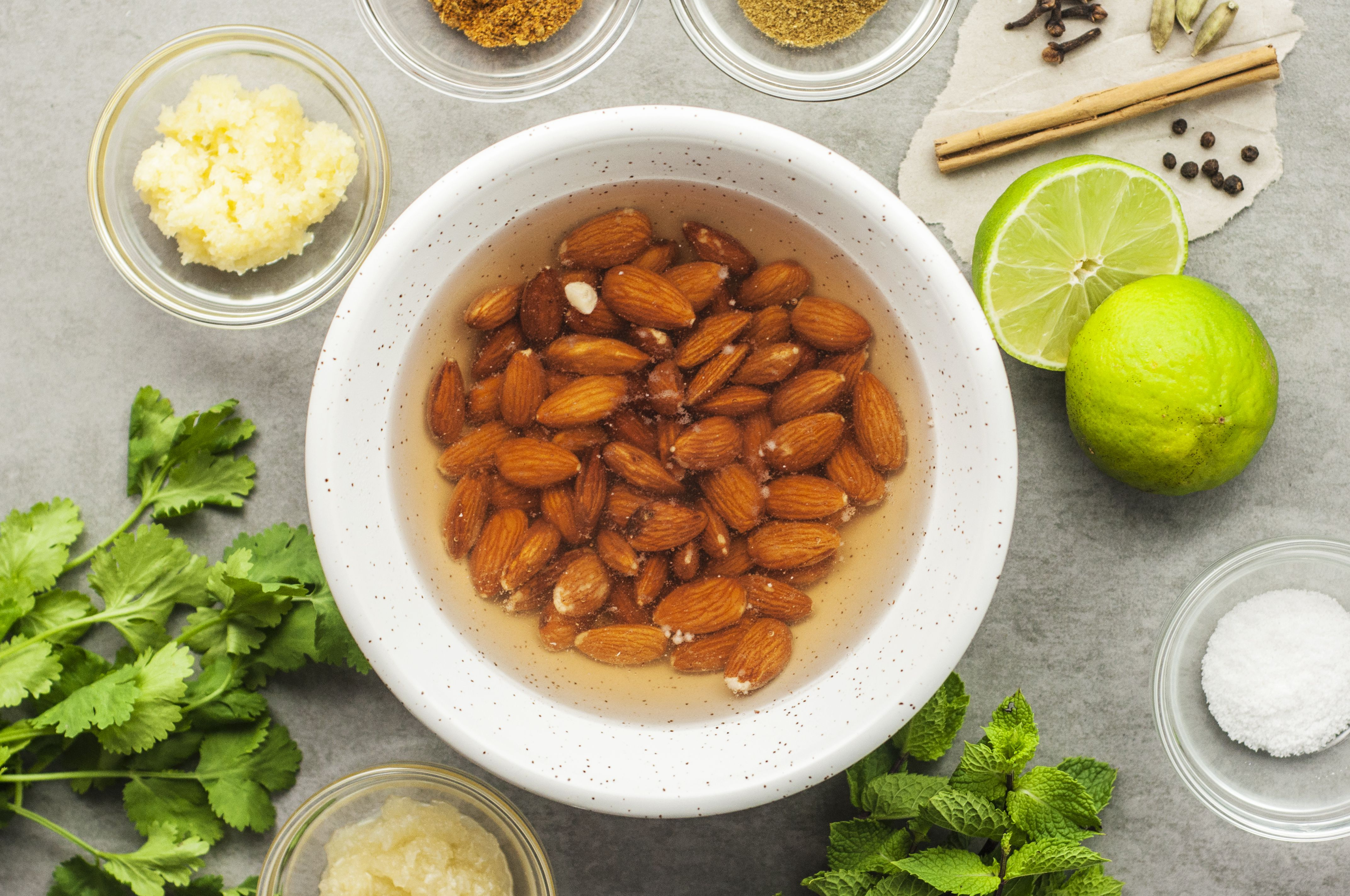 Add almonds to bowl with water