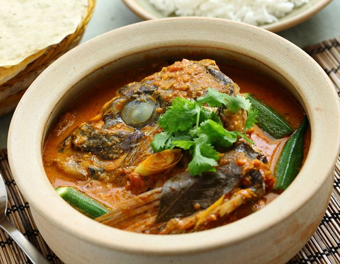 Thai Fish Curry in earthenware pot