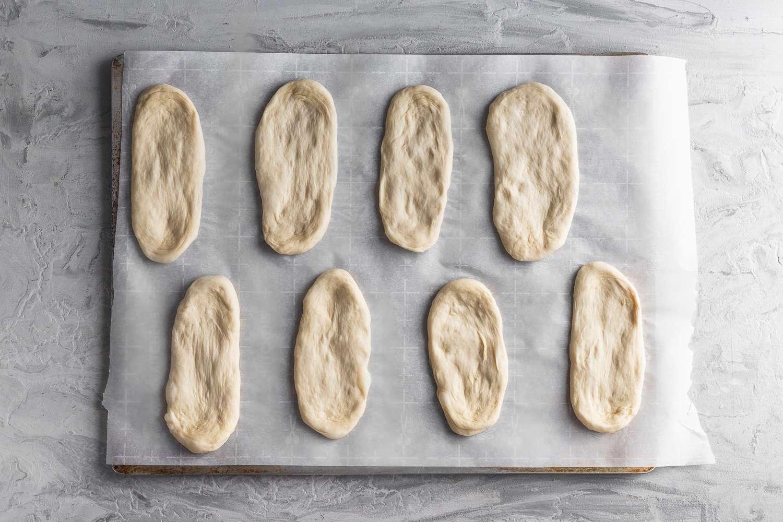 dough pieces on a parchment paper lined baking sheet