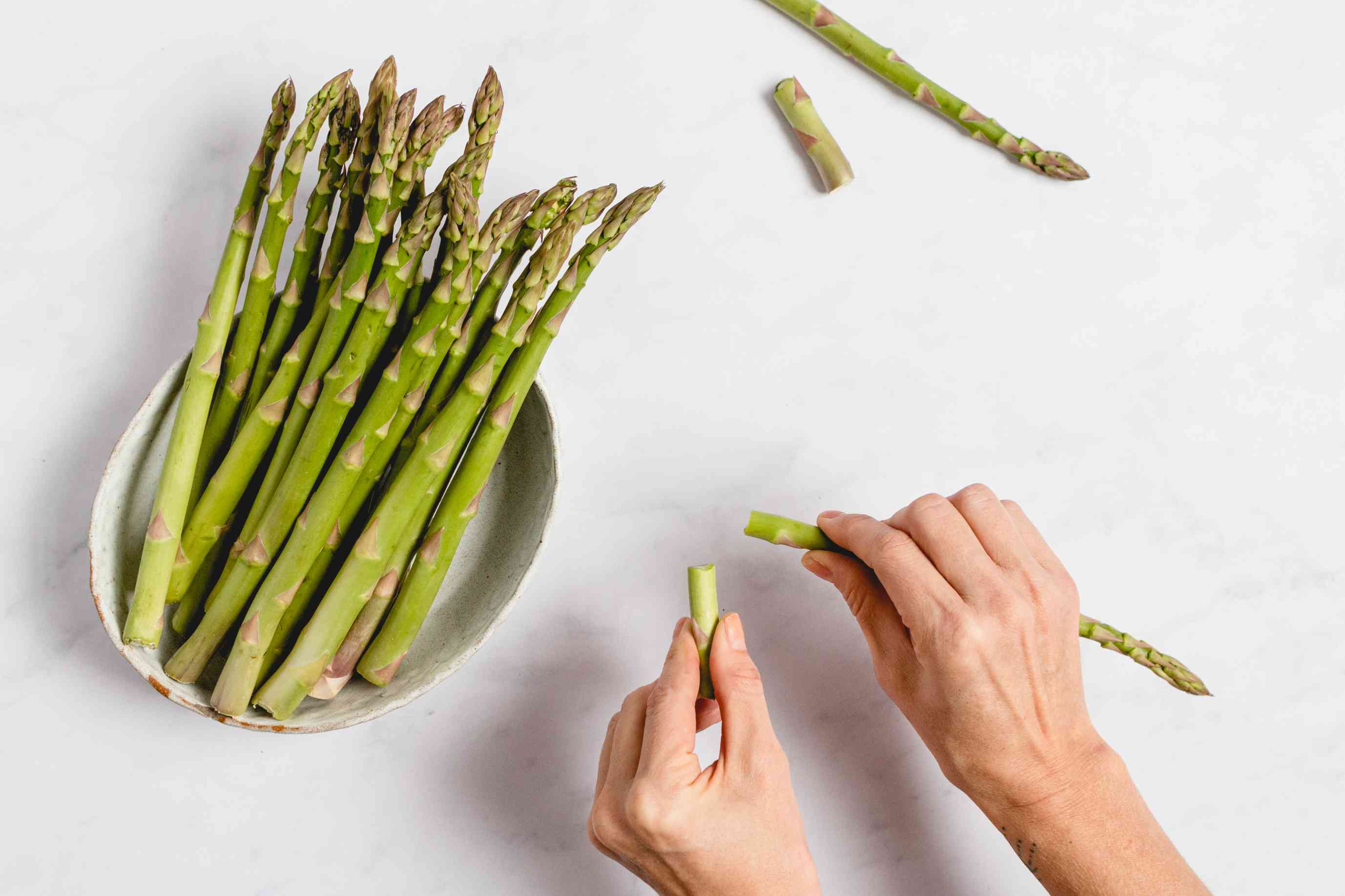 asparagus will break at the point between the tender tips and the tougher ends