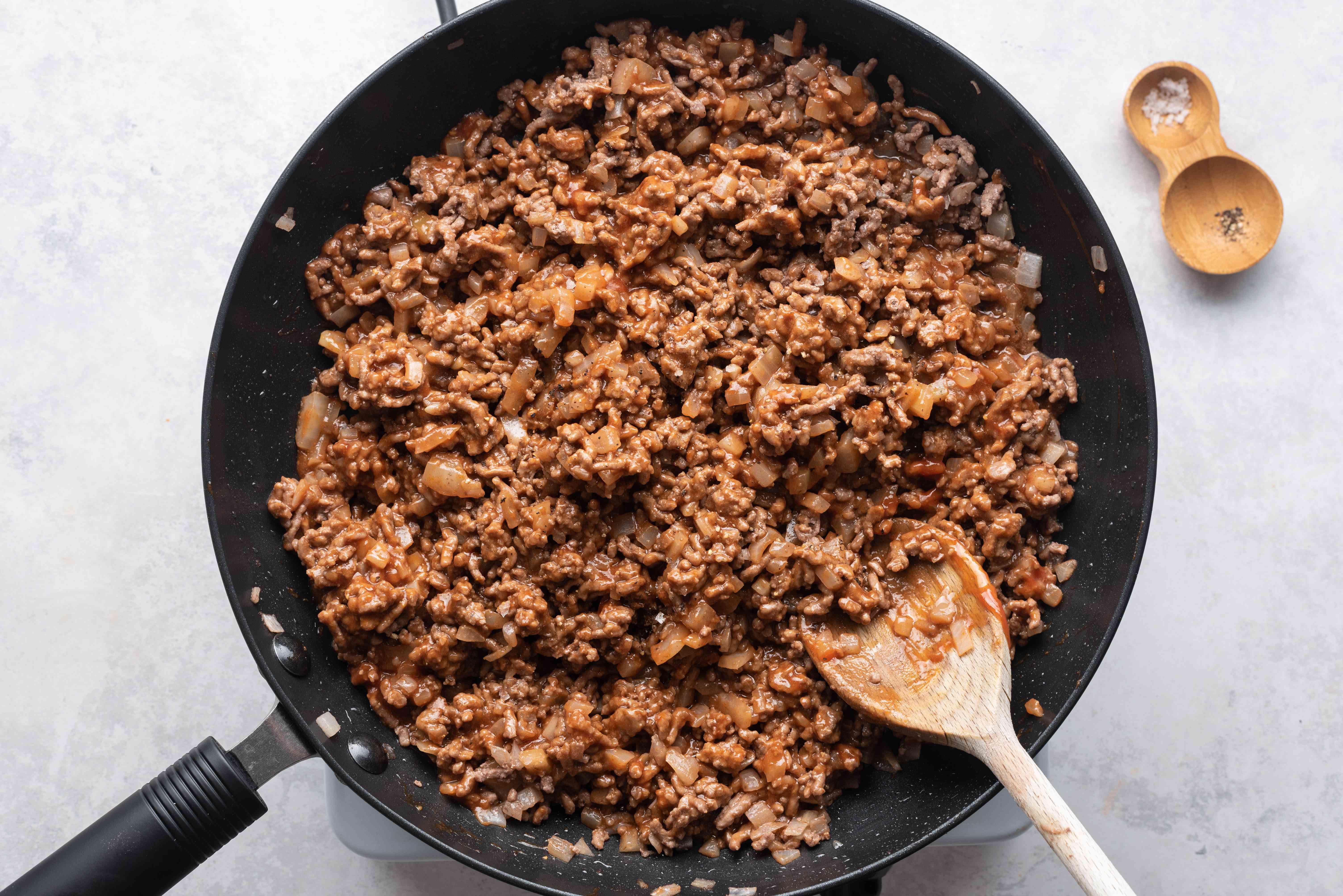 seasoned beef mixture cooking in a skillet
