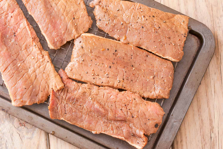 Arrange beef strips on rack