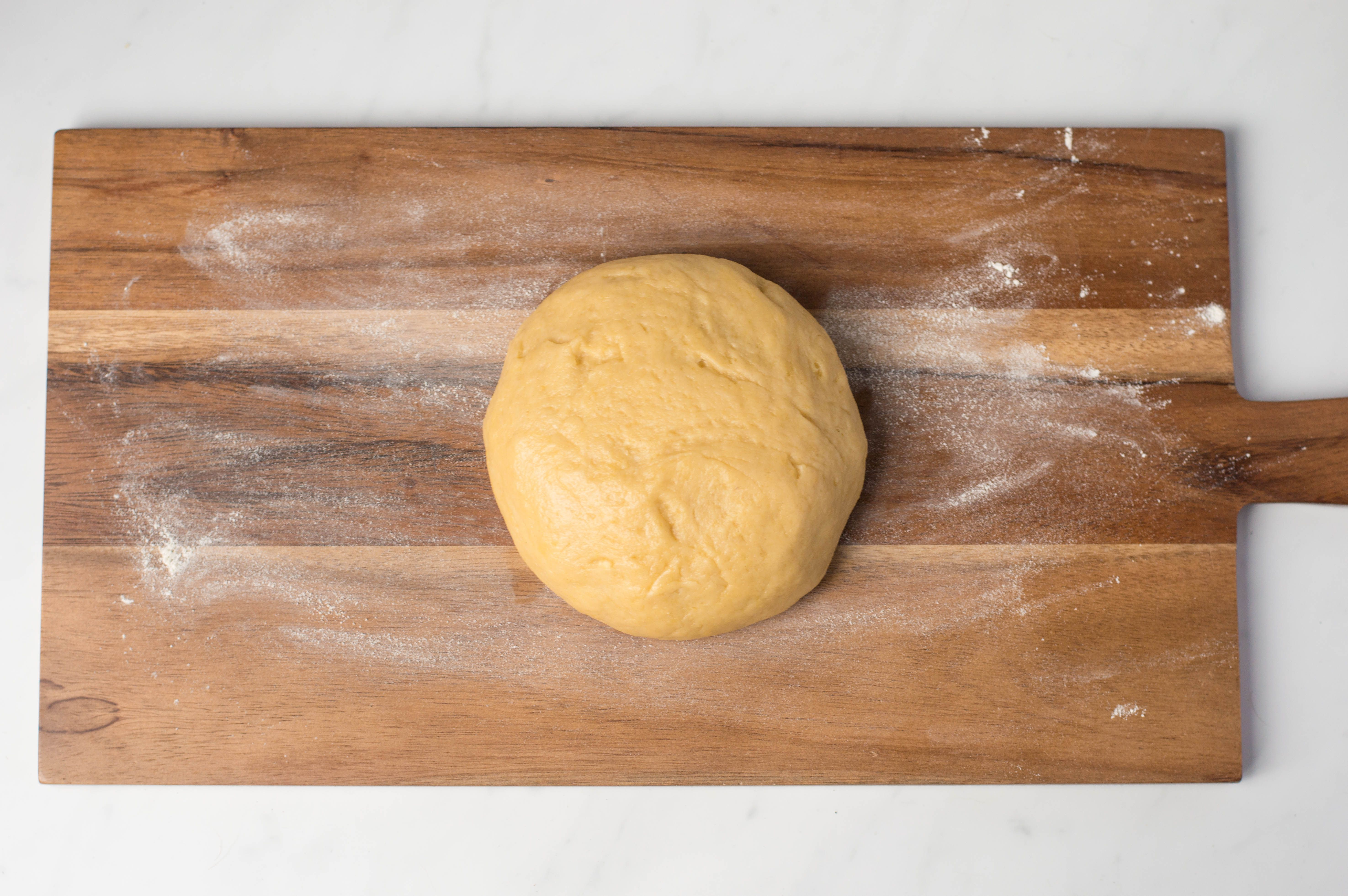 Hot water pastry dough on wooden cutting board