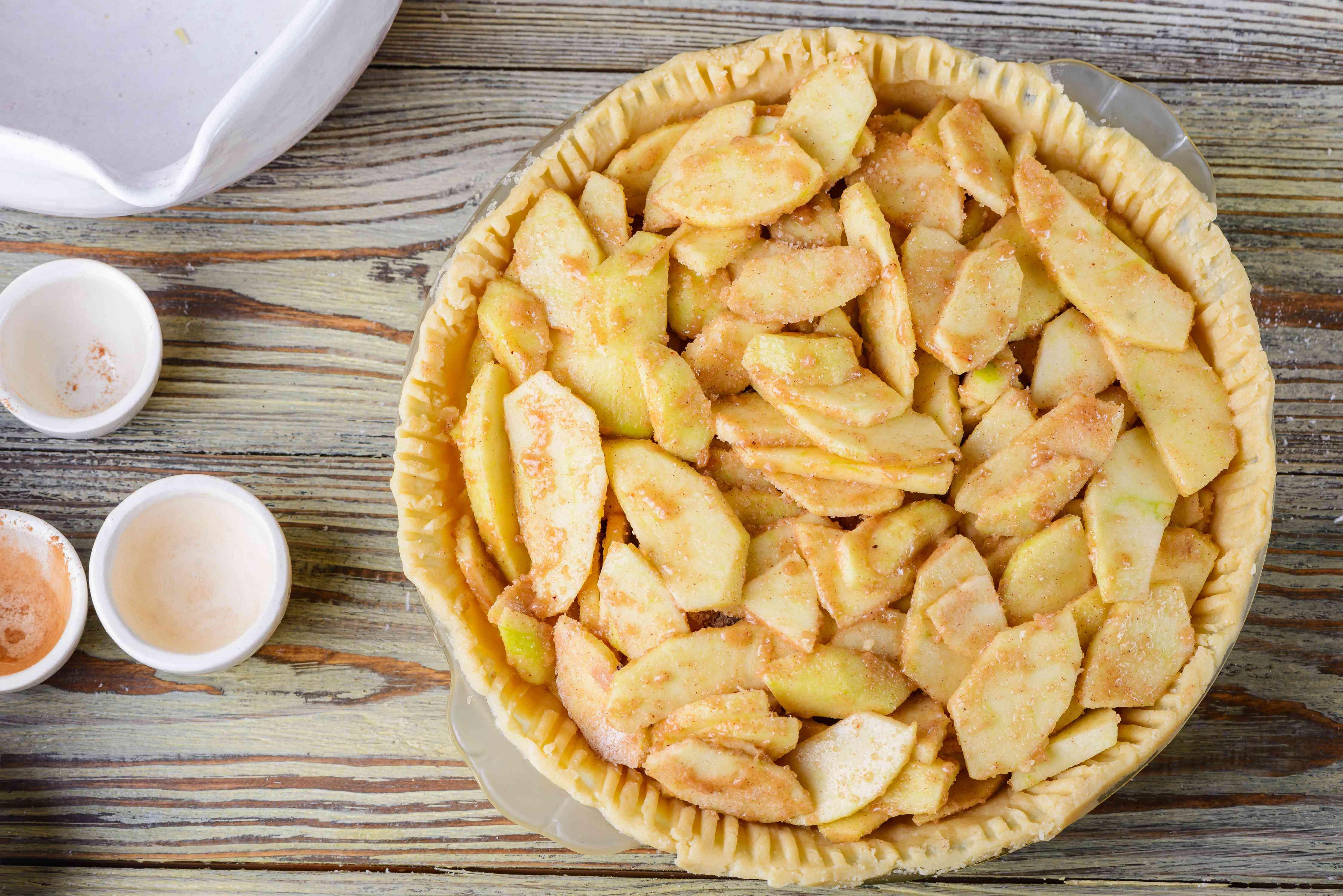 Pour apples into dough