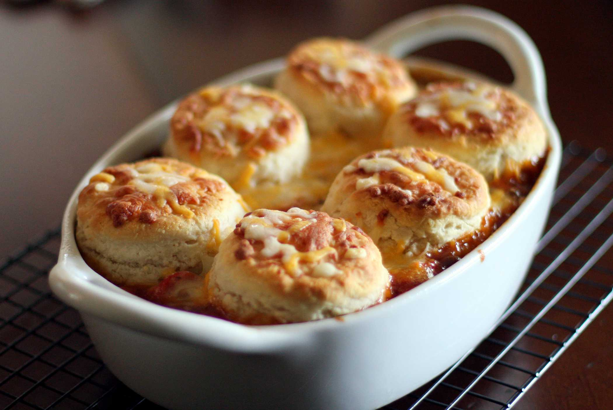 Baked beans and hot dogs with a biscuit topping