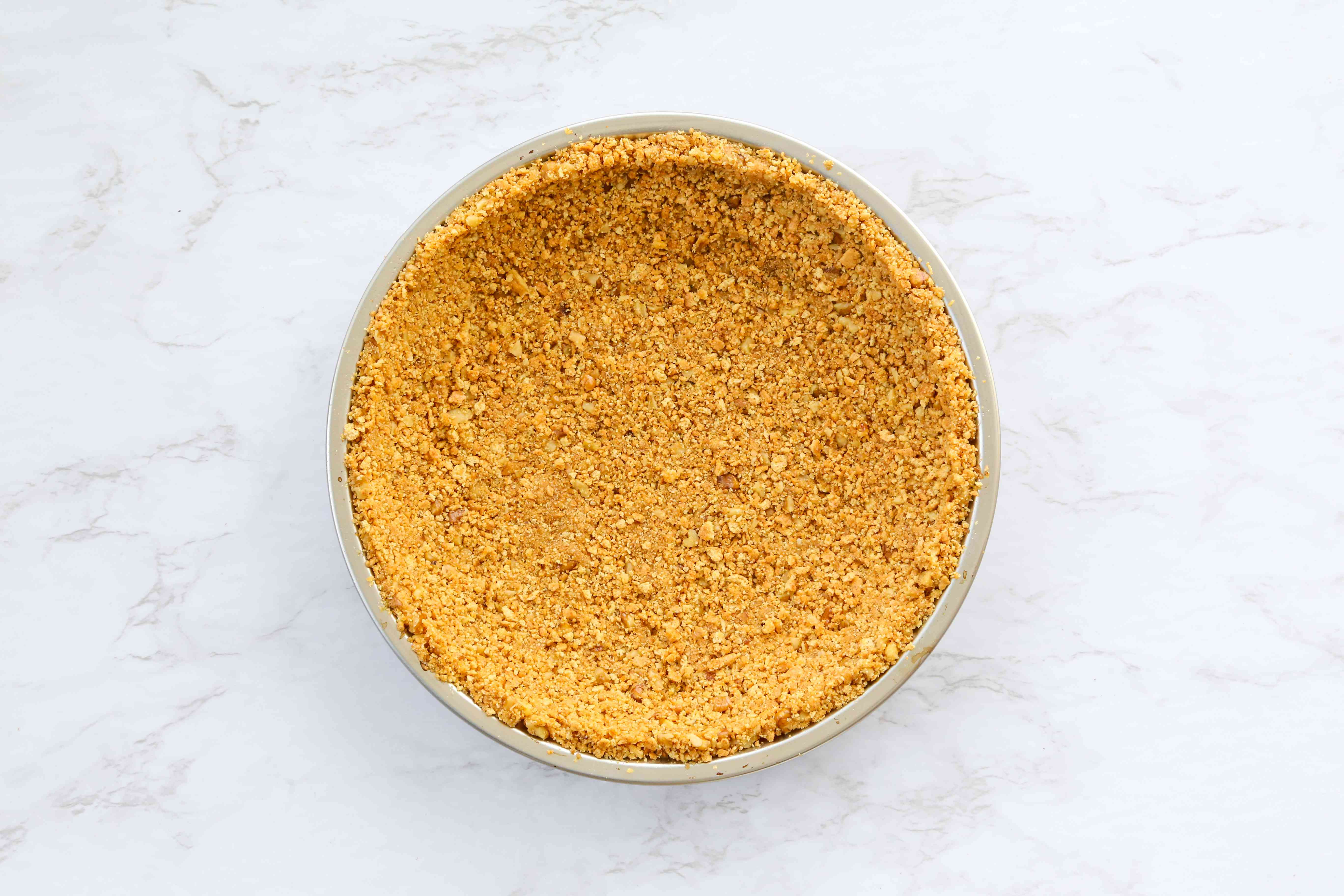 Press the graham cracker mixture into the bottom of a pie dish