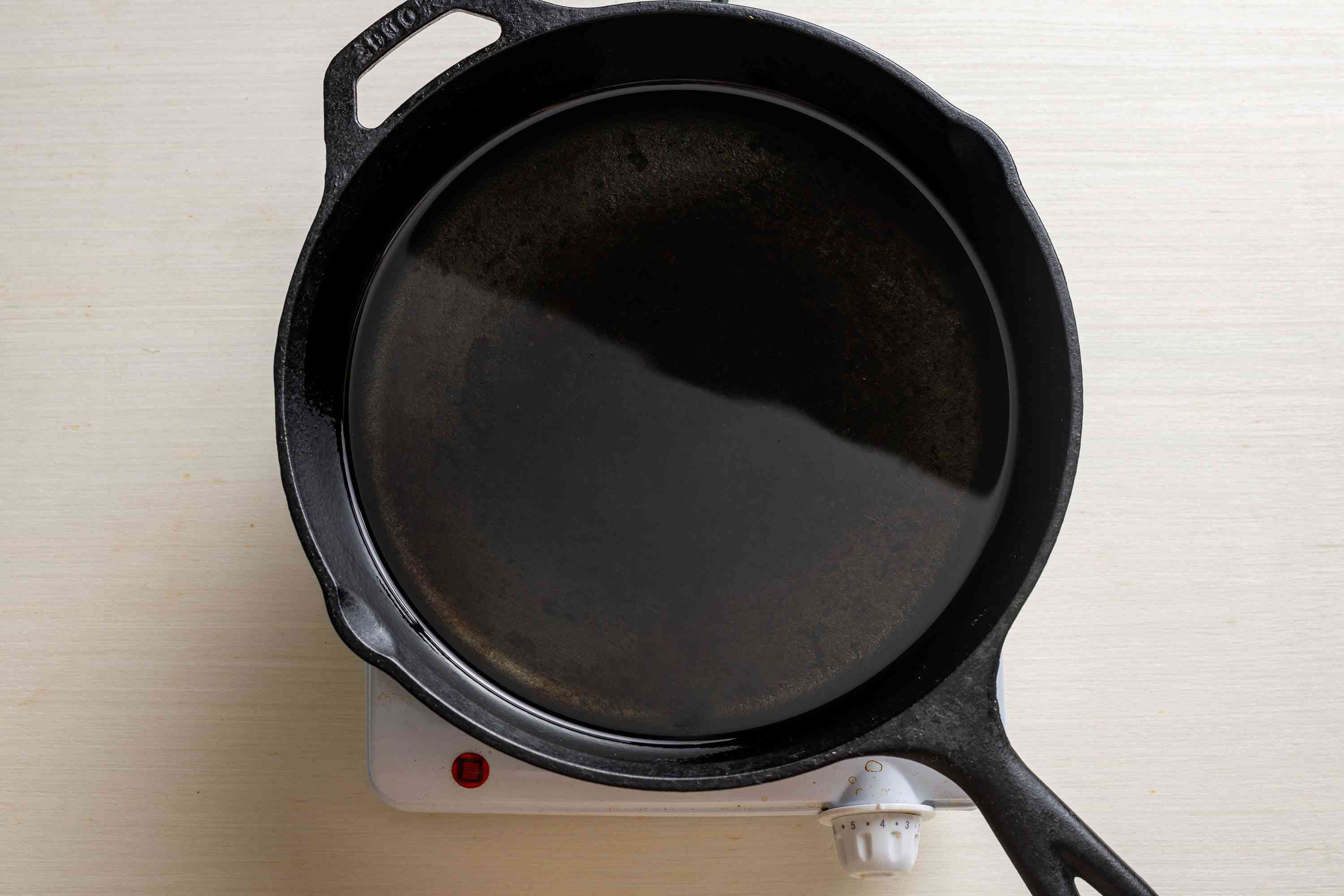 cast iron skillet with oil