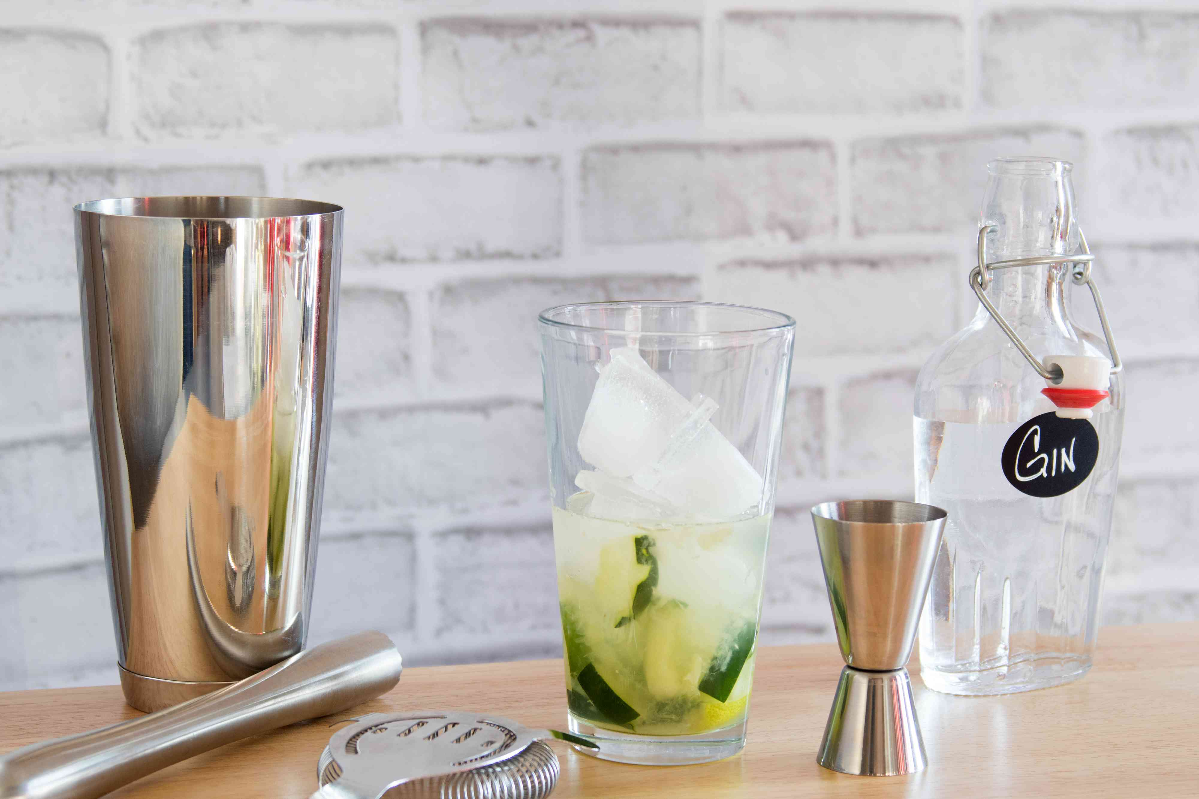 Mixing a Cucumber Collins Cocktail