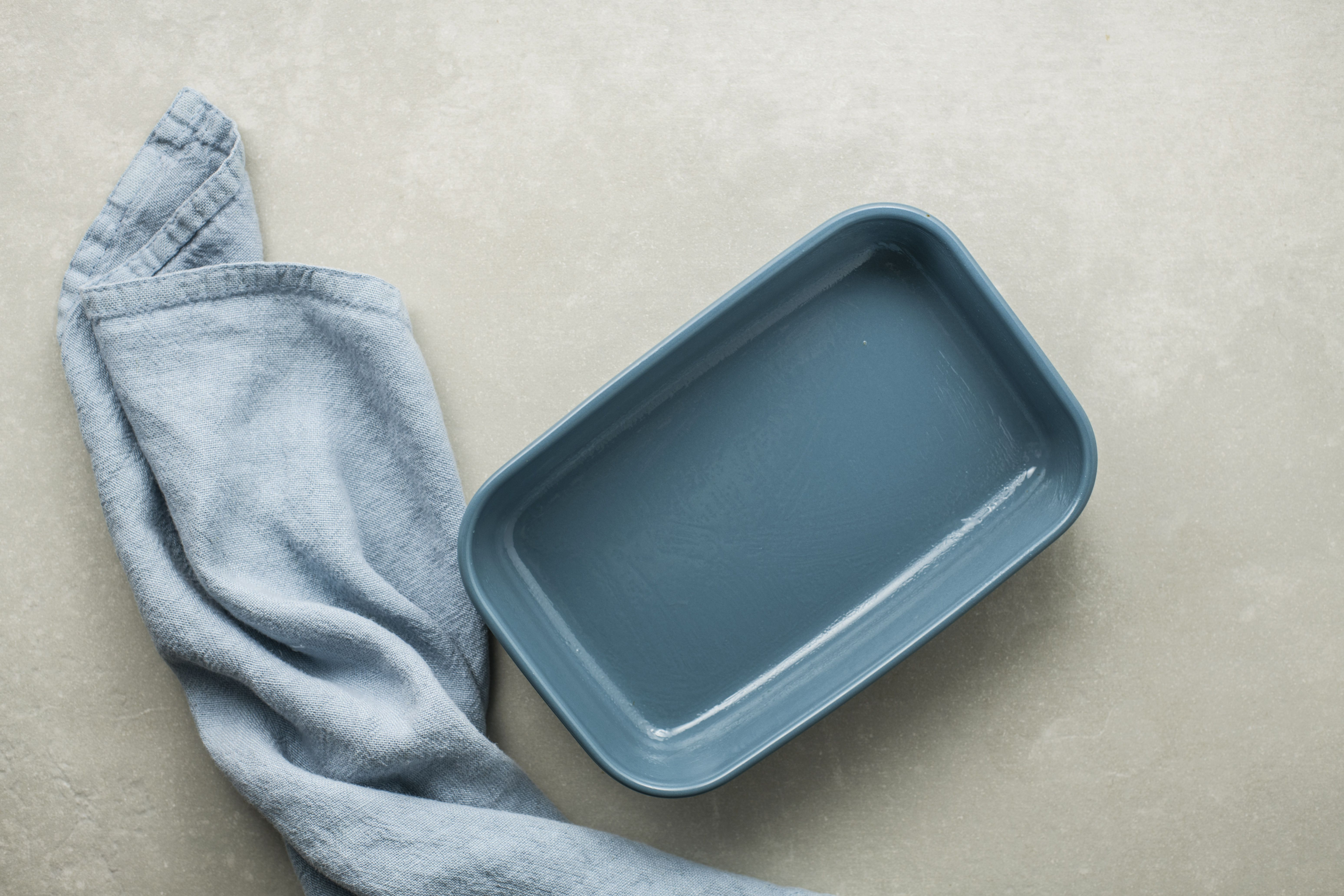 A blue casserole dish on a table