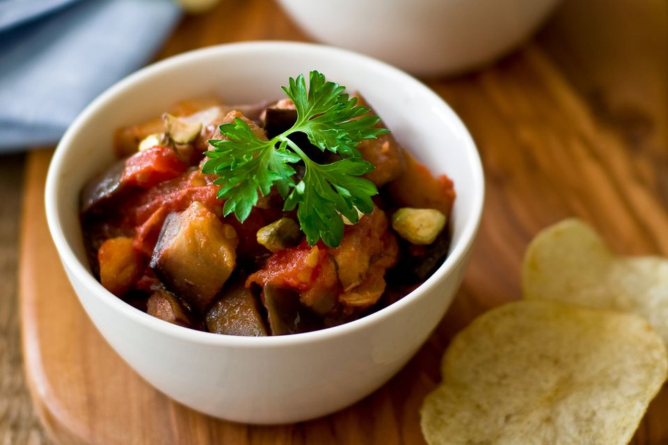 Braised eggplant and potatoes topped with parsley