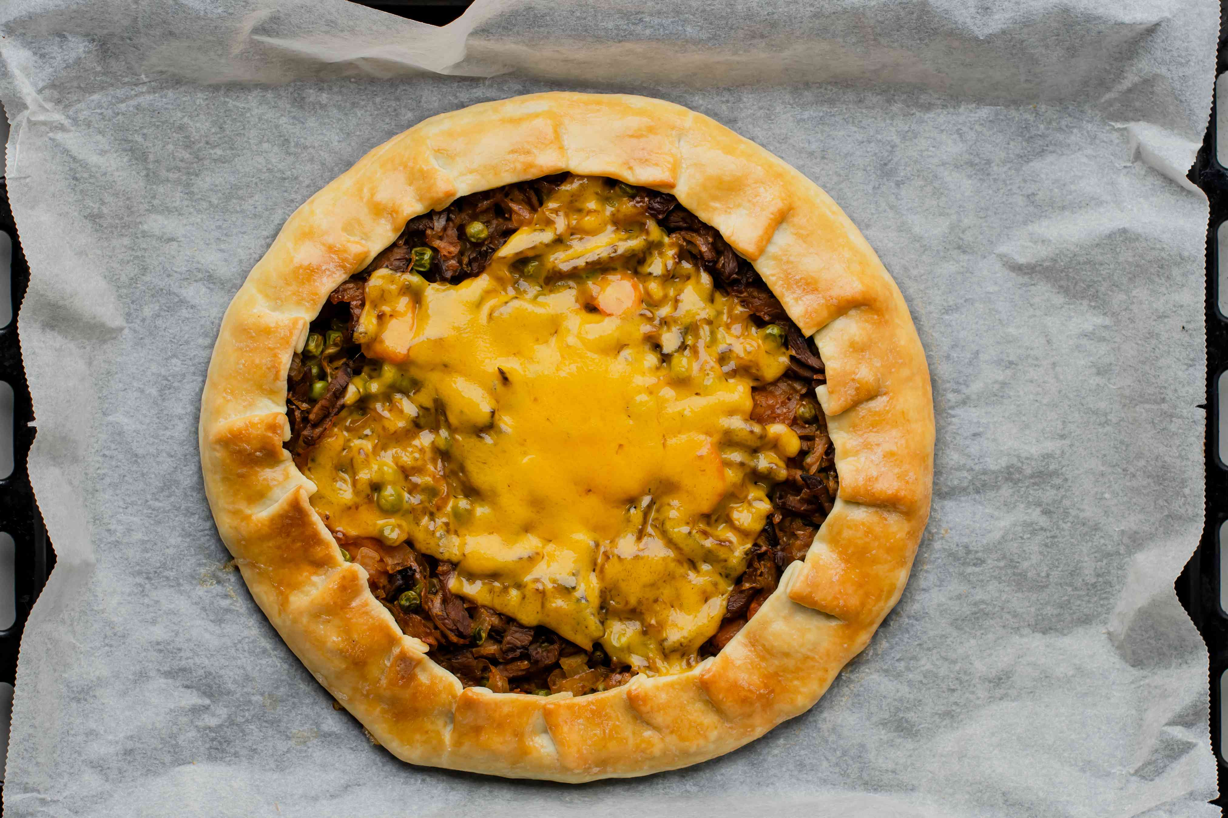 Top the pie with cheese