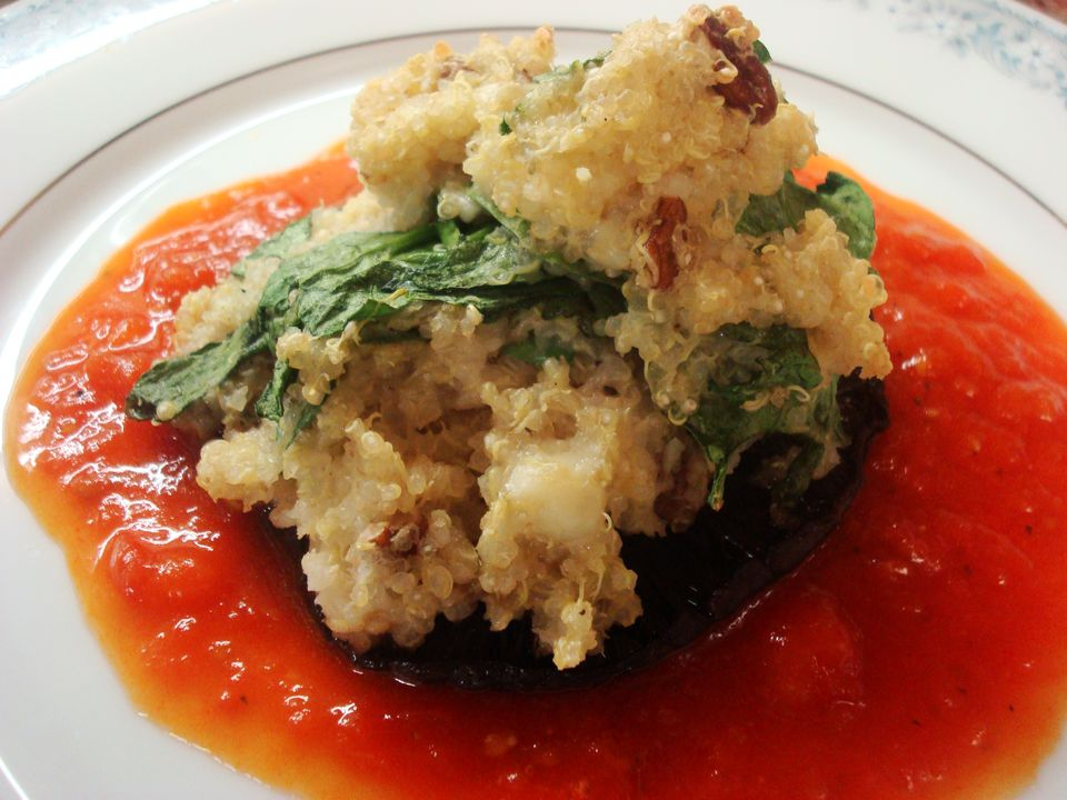 A close up of quinoa-stuffed portobello mushrooms