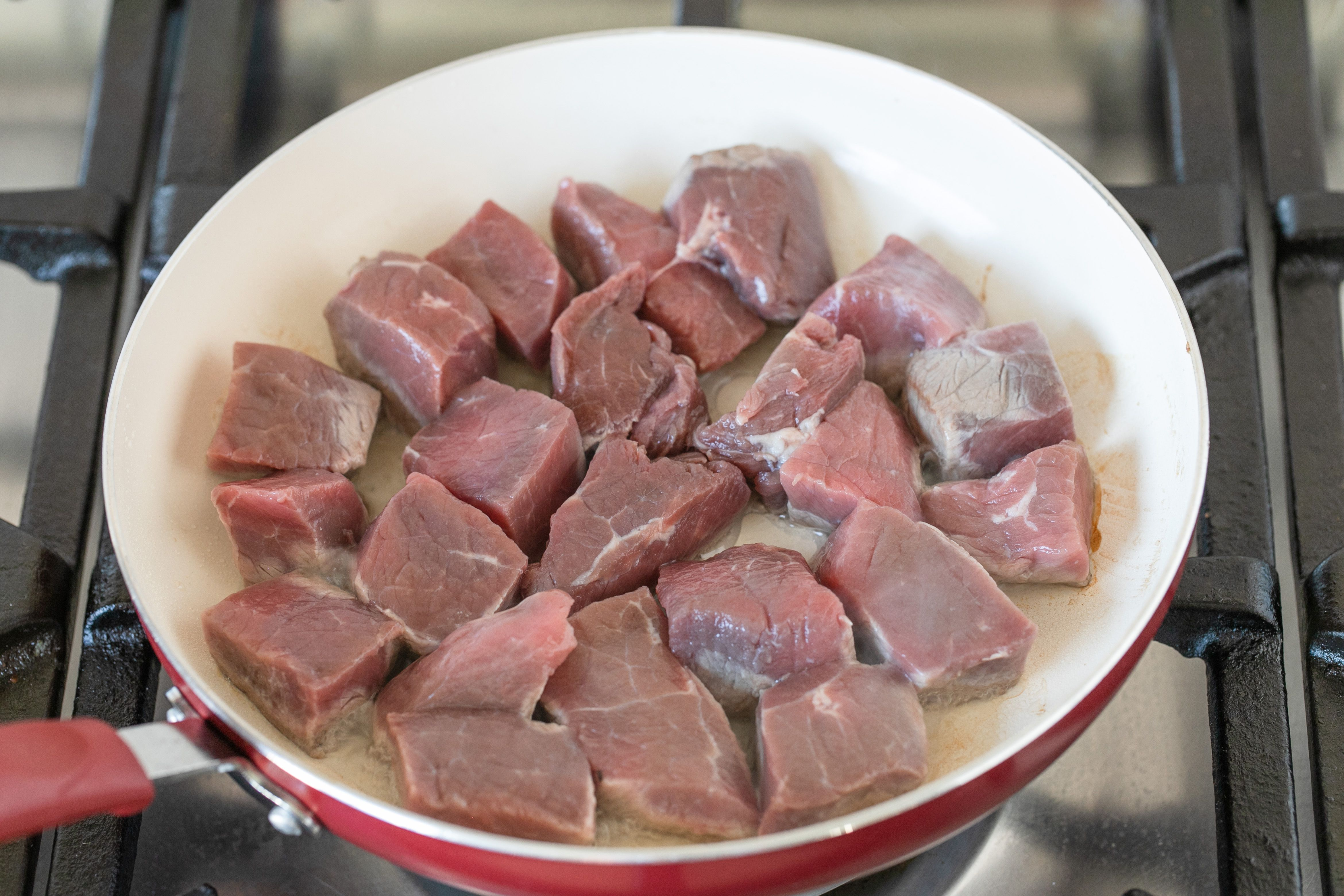 Cubed beef in a skillet